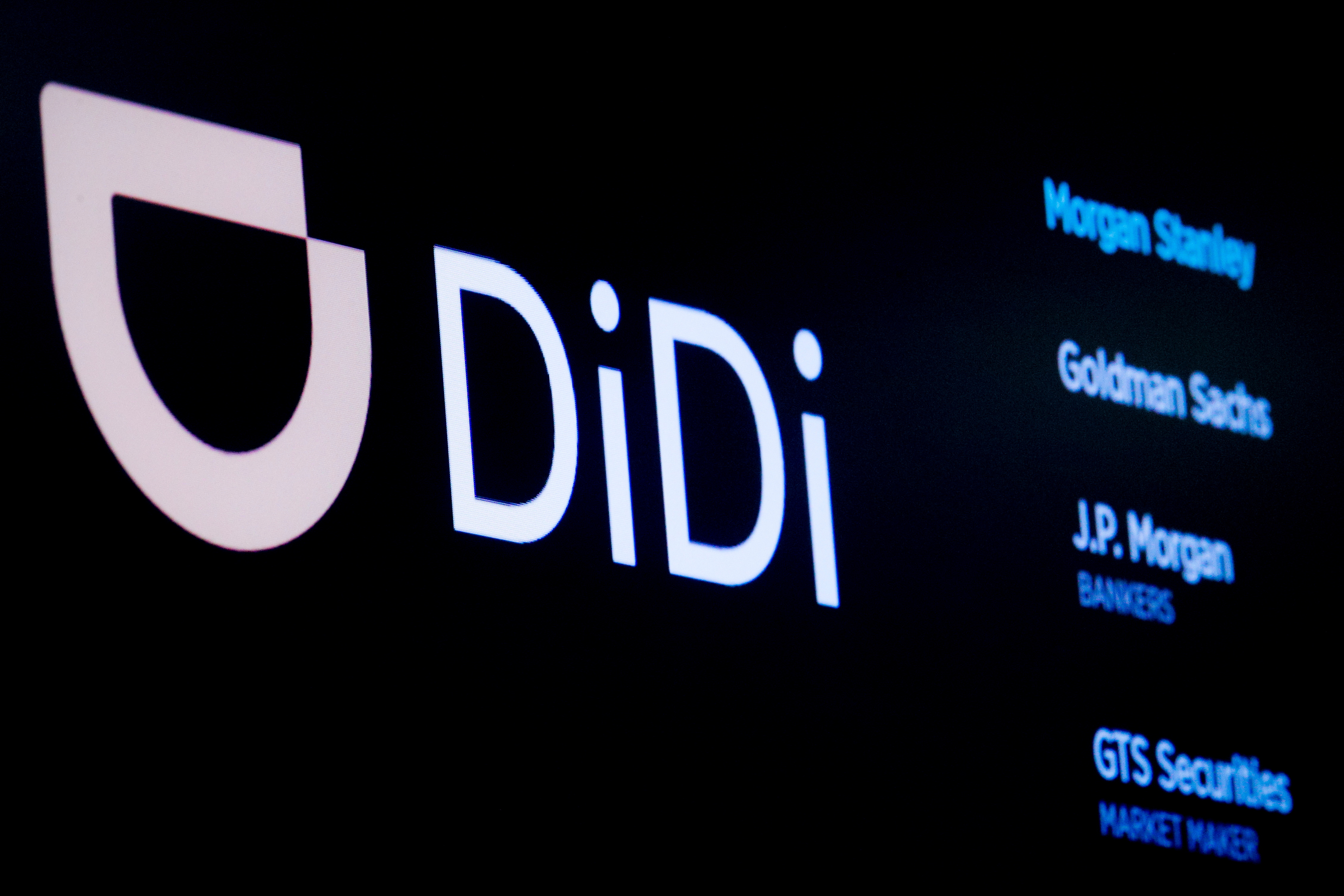 The logo for Chinese ride-hailing company Didi Global Inc is pictured during the IPO on the New York Stock Exchange (NYSE) floor in New York City, U.S., June 30, 2021.  REUTERS/Brendan McDermid/File Photo