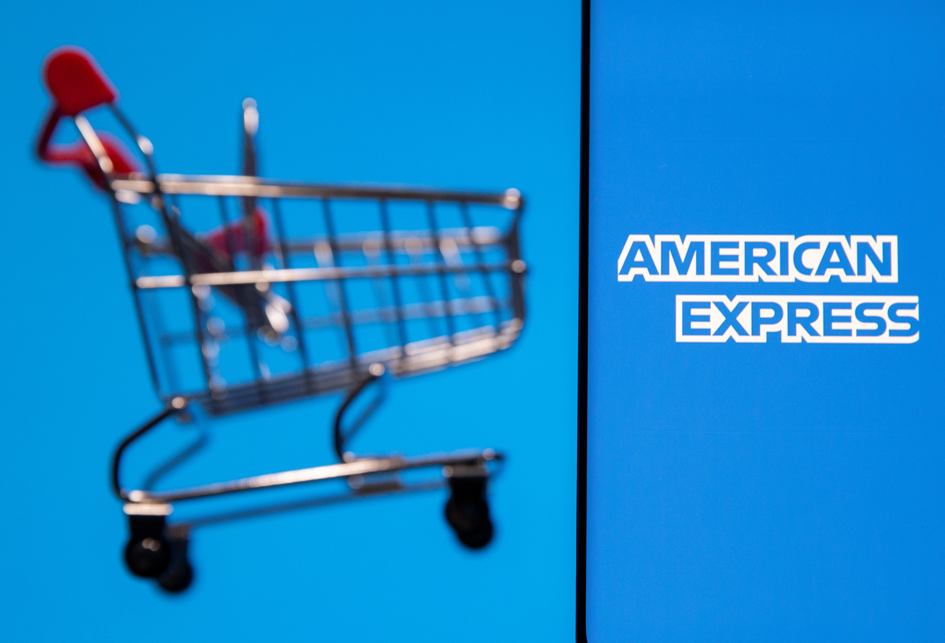 Smartphone with American Express logo is placed near toy shopping cart in this illustration taken, July 15, 2021. REUTERS/Dado Ruvic/Illustration
