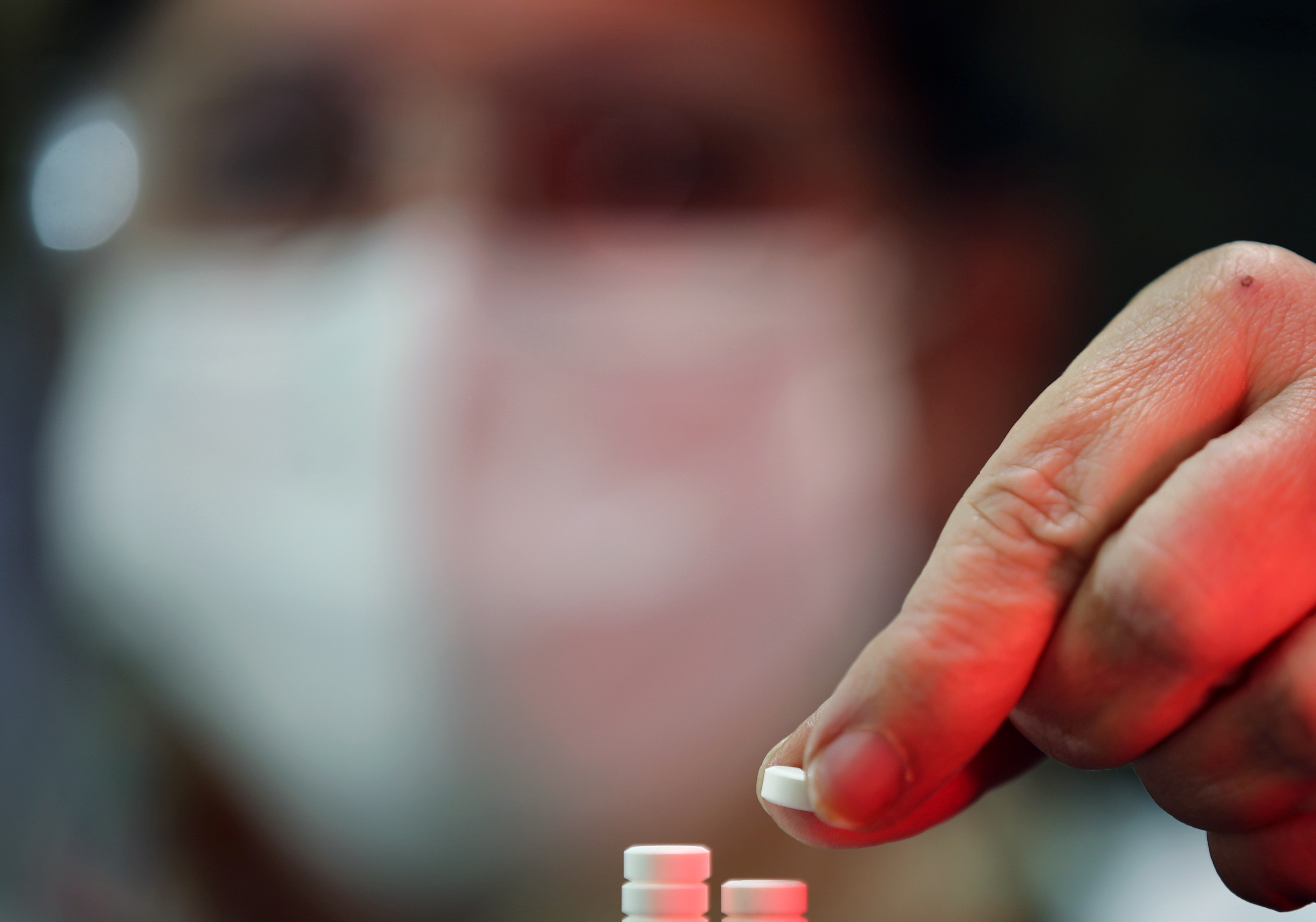 A health worker checks chloroquine pills distributed by the Ministry of Health at the pharmacy of the Nossa Senhora da Conceicao hospital, amid the coronavirus disease (COVID-19) outbreak in Porto Alegre, Brazil, May 26, 2020. REUTERS/Diego Vara