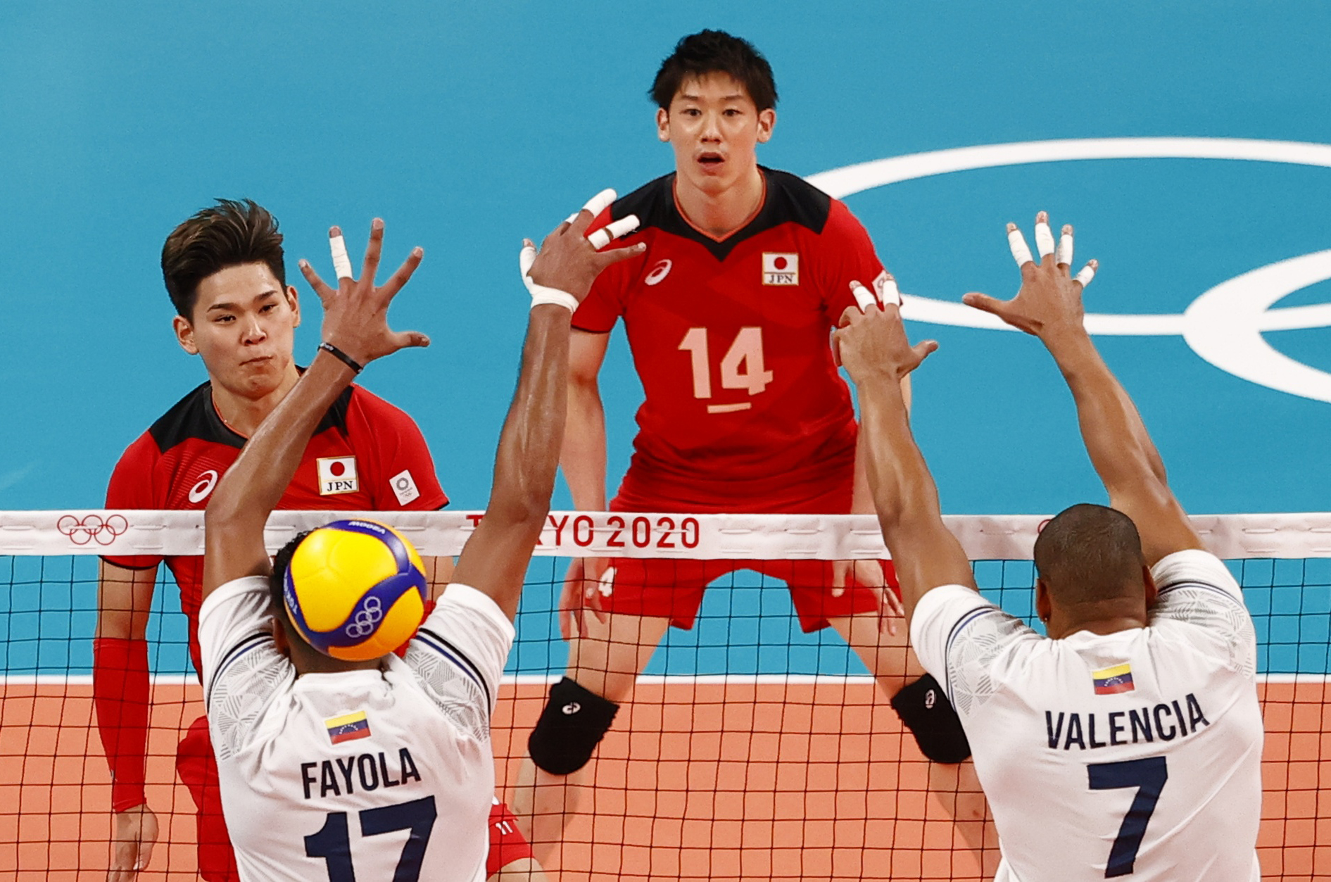 Tokyo 2020 Olympics -Volleyball - Men's Pool A - Japan v Venezuela - Ariake Arena, Tokyo, Japan – July 24, 2021. Yuki Ishikawa of Japan in action with Edson Valencia of Venezuela. REUTERS/Carlos Garcia Rawlins