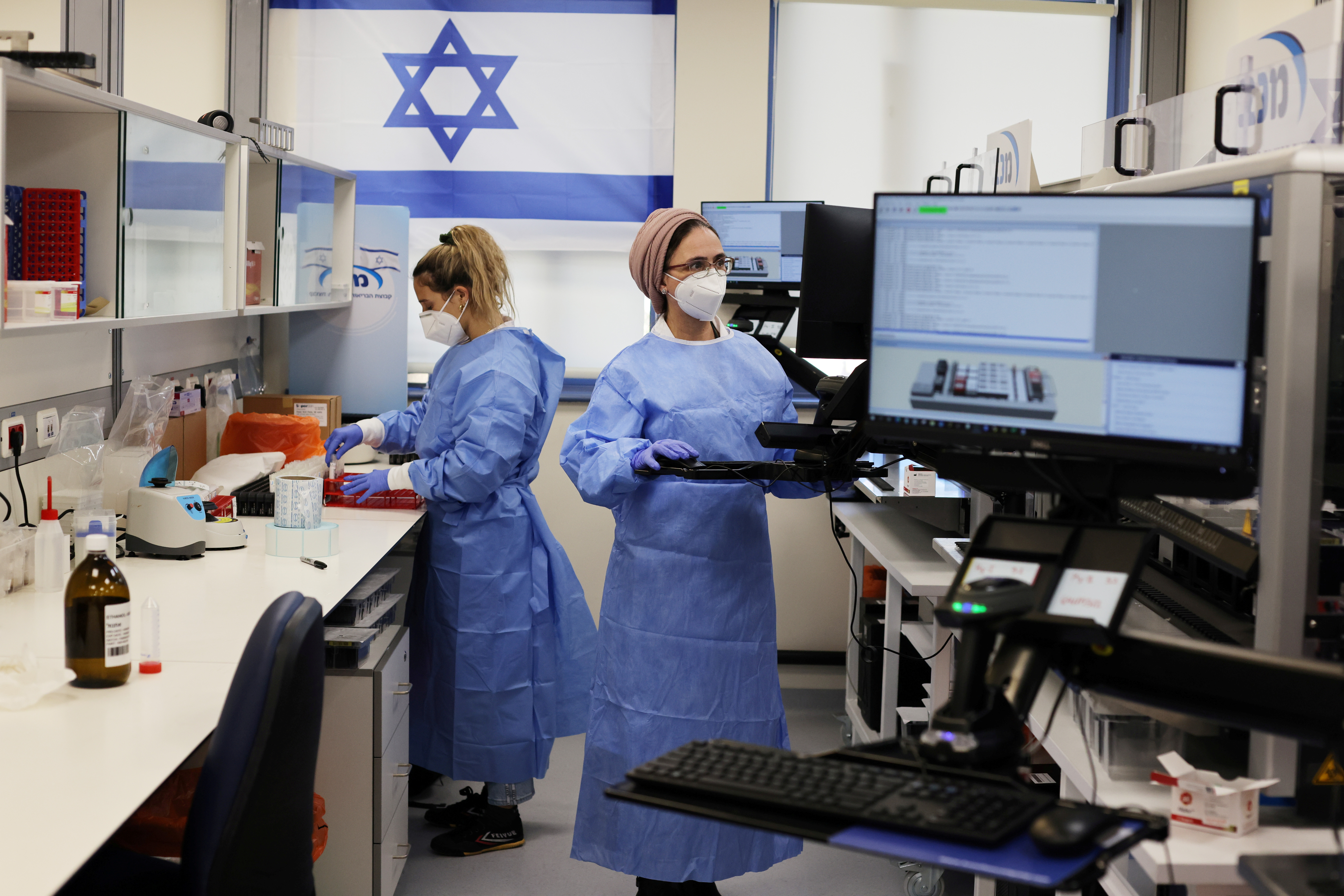 Technicians work at Healthcare Maintenance Organization (HMO) Maccabi's coronavirus disease (COVID-19) public laboratory, performing diverse and numerous tests, in Rehovot, Israel February 9, 2021. REUTERS/Ammar Awad/File Photo