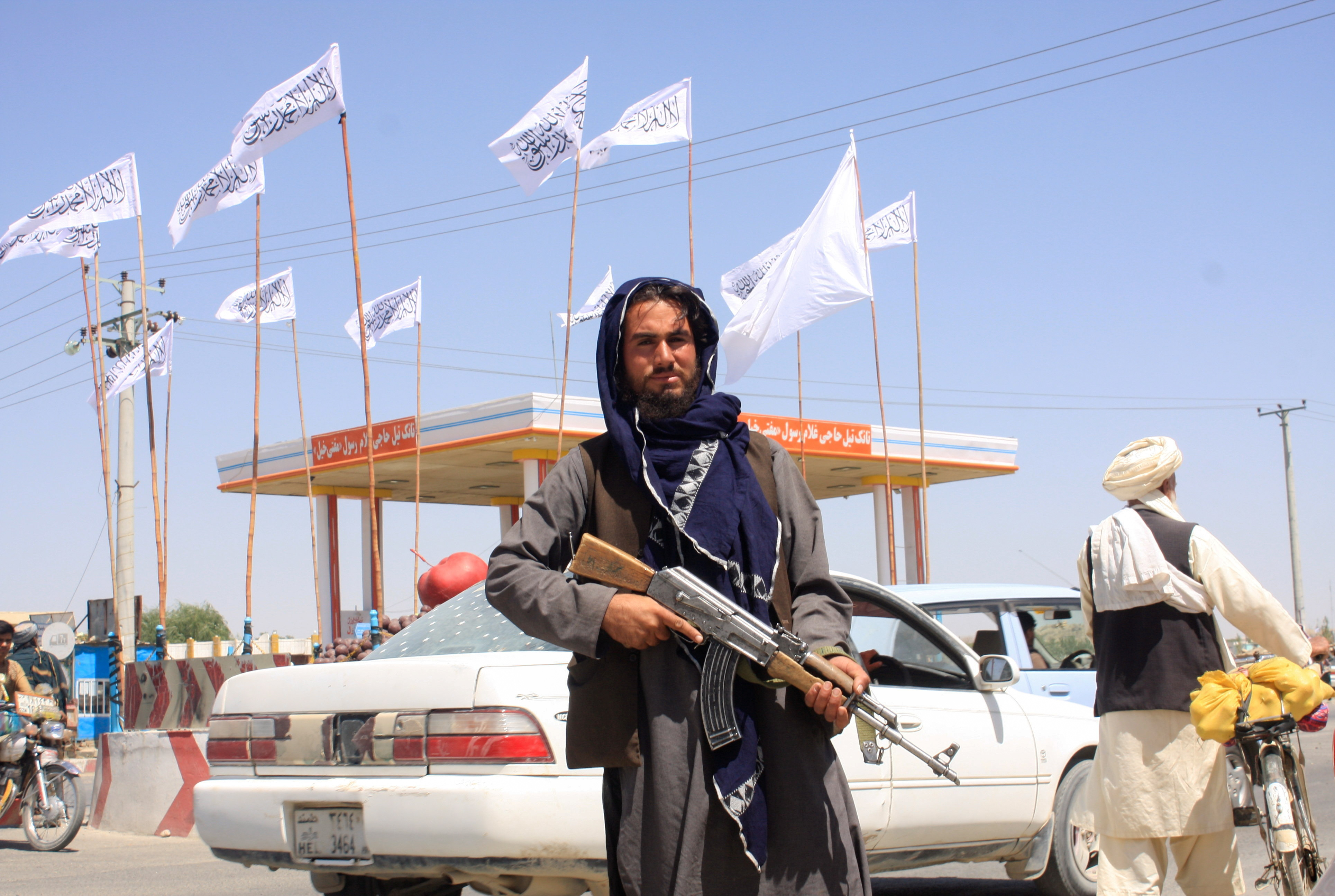 A Taliban fighter looks on as he stands at the city of Ghazni, Afghanistan August 14, 2021. REUTERS/Stringer