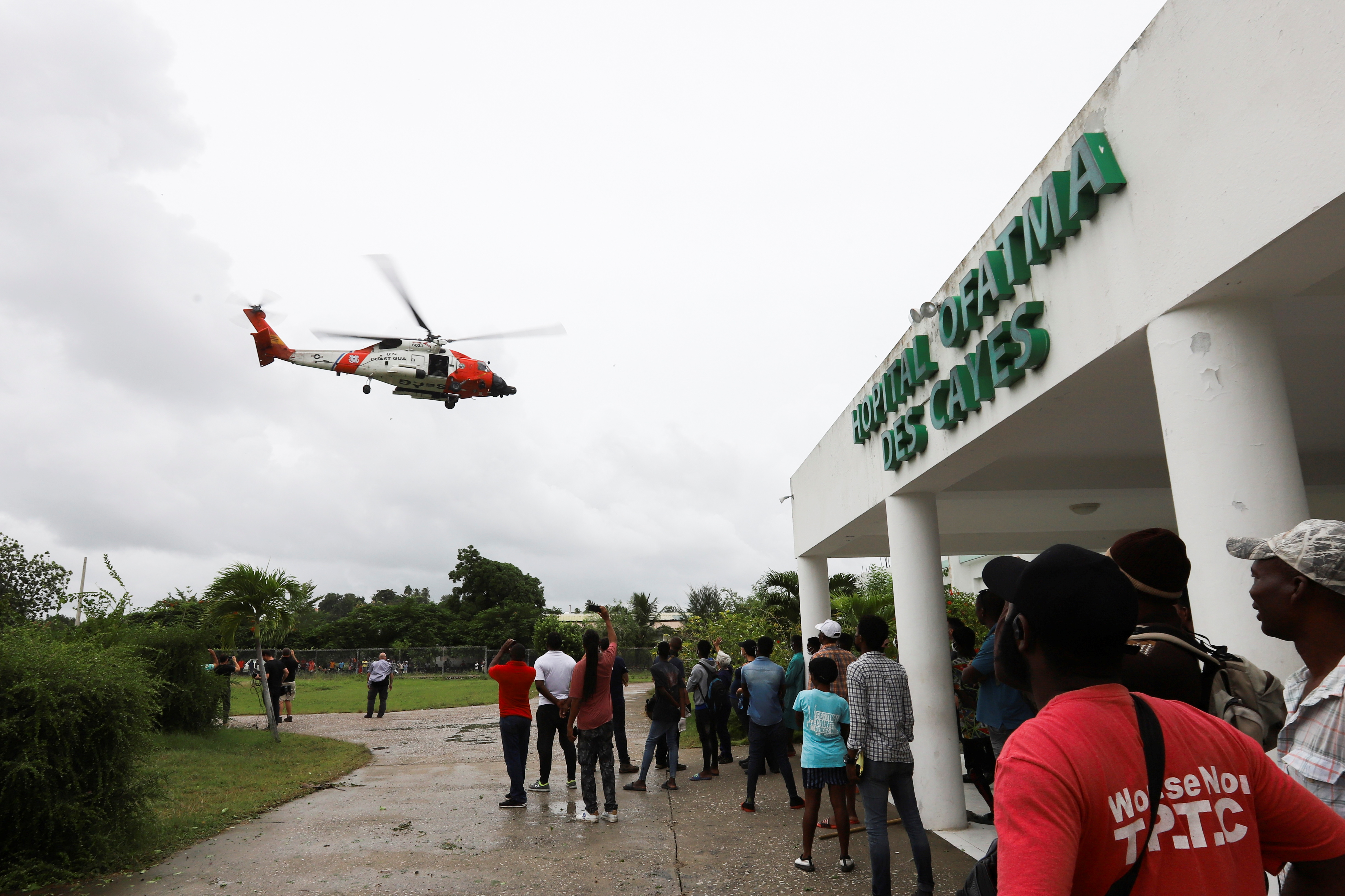 A U.S. Coast Guard helicopter lifts off during a medical evacuation of people injured in Saturday's 7.2 magnitude earthquake, in Les Cayes, Haiti, August 17, 2021. REUTERS/Estailove St-Val