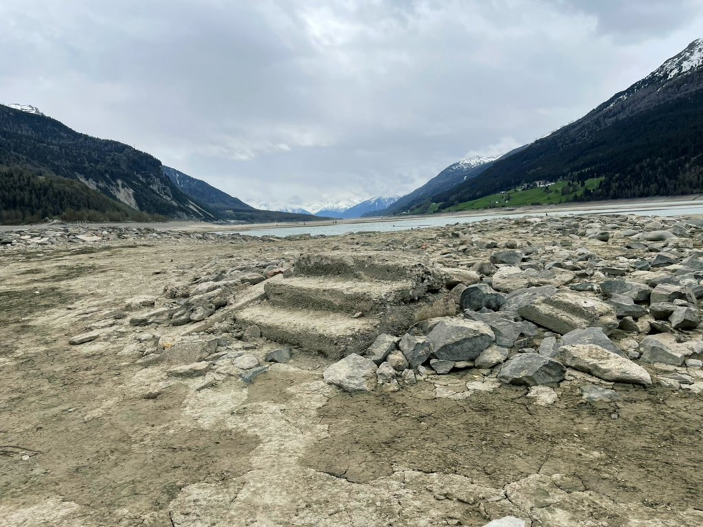 The remains of a tiny village are revealed for the first time since 1950, as a lake is drained for repair works of a hydroelectric plant, that replaced the village of Curon 71 years ago, at Resia Lake, Italy May 16, 2021.  Courtesy LUISA AZZOLINI/Handout via REUTERS