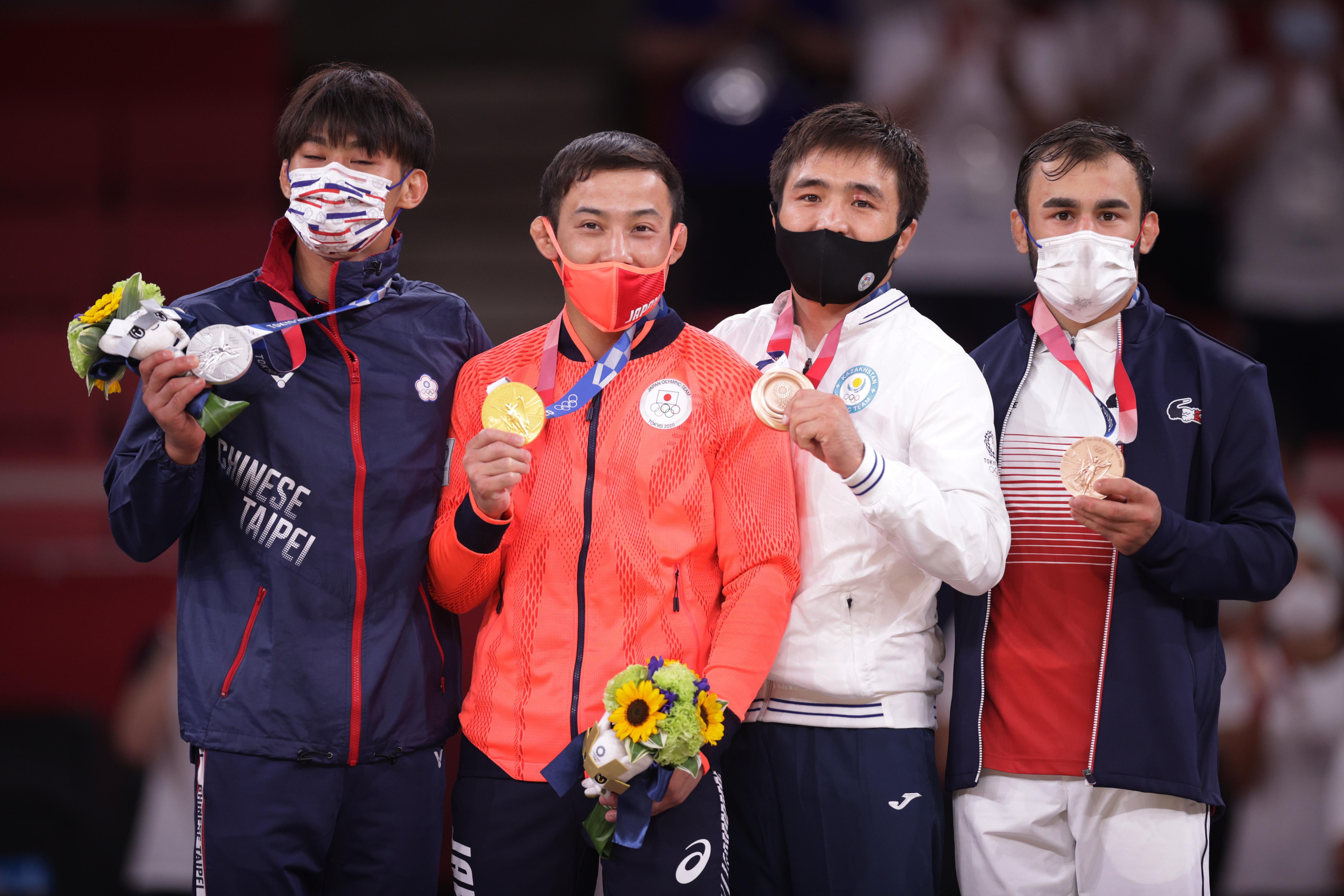 Tokyo 2020 Olympics - Judo - Men's 60kg - Medal Ceremony - Nippon Budokan - Tokyo, Japan - July 24, 2021. Gold medallist Naohisa Takato of Japan celebrates with silver medallist Yang Yung Wei of Taiwan, bronze medallist Yeldos Smetov of Kazakhstan, and bronze medallist Luka Mkheidze of France REUTERS/Hannah Mckay
