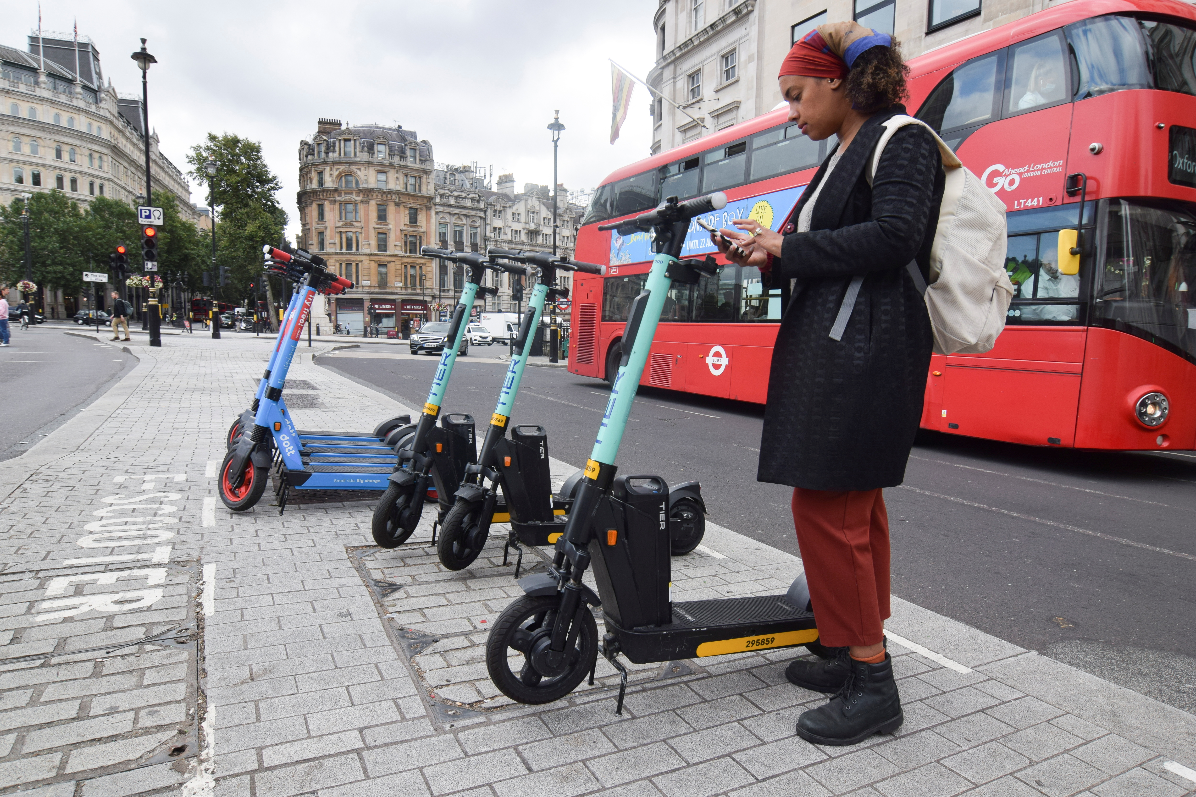 Georgia Yexley, UK and Ireland head of cities at micromobility firm Tier, gets ready to demonstrate an e-scooter in London, Britain, August 25, 2021. Picture taken August 25, 2021. REUTERS/Nick Carey