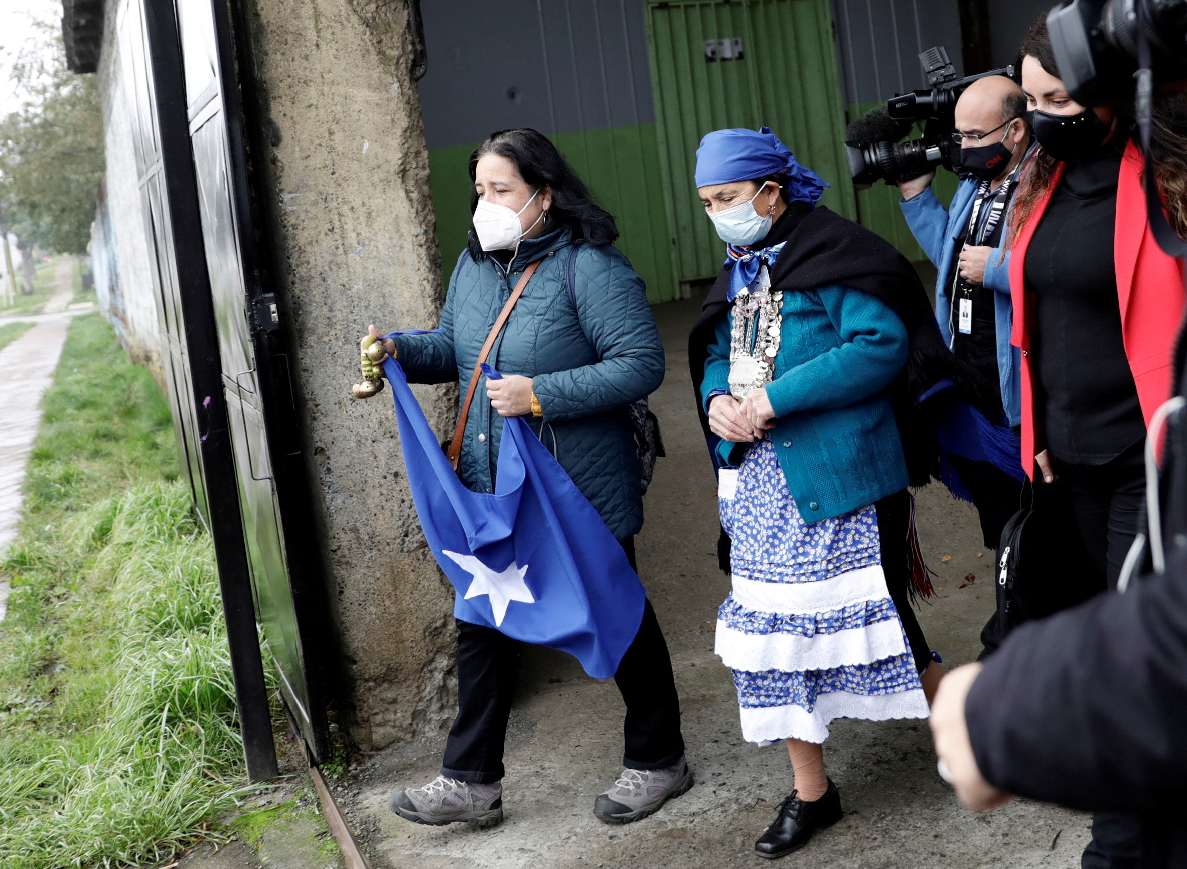 Mapuche spiritual authority and constituent candidate Francisca Linconao leaves after casting her vote in the election for governors, mayors, councillors and constitutional assembly members to draft a new constitution to replace Chile's charter, in Temuco, Chile May 16, 2021. REUTERS/Juan Gonzalez/File Photo