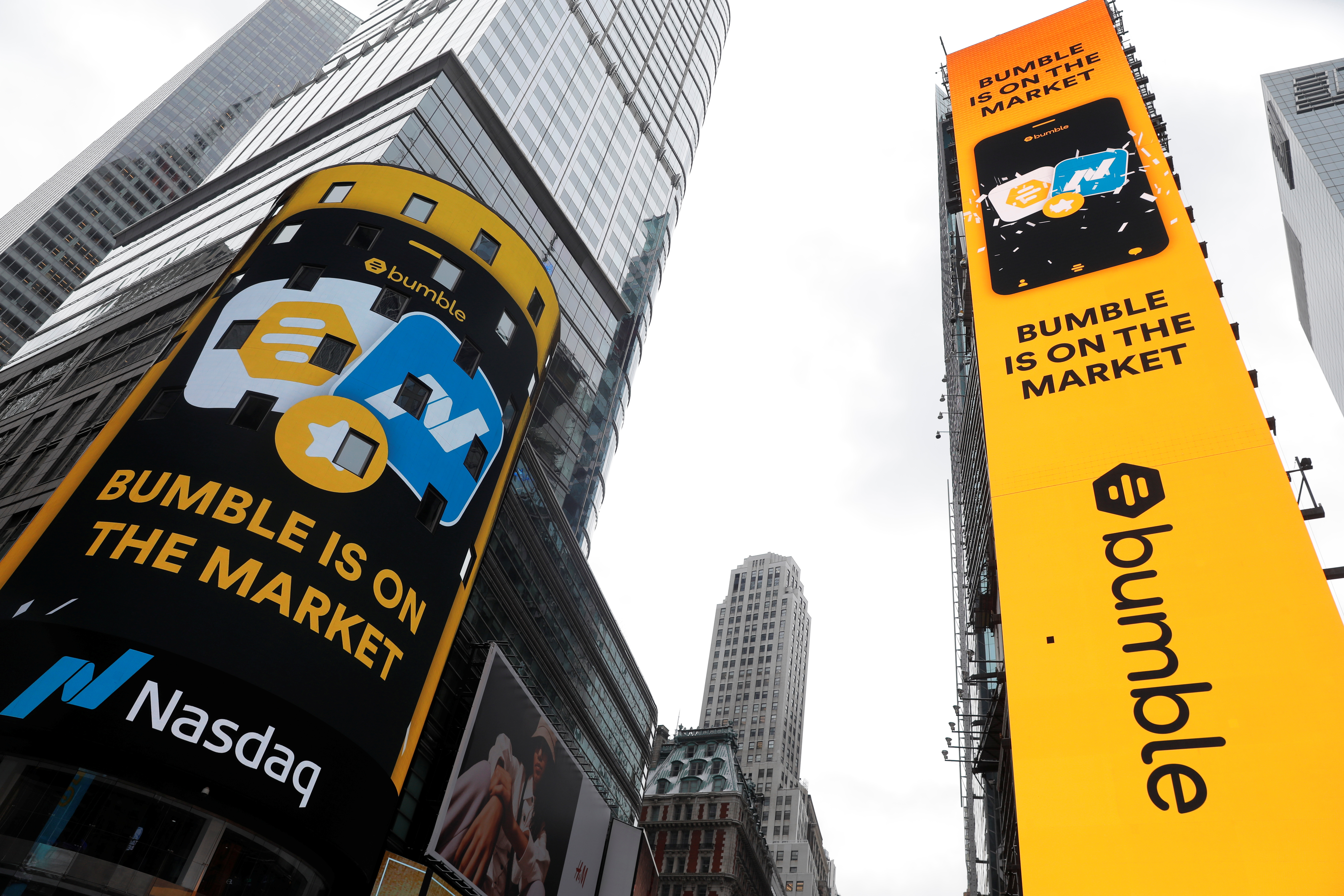 Displays in Times Square outside the Nasdaq MarketSite are pictured as dating app operator Bumble Inc. (BMBL) made its debut on the Nasdaq stock exchange during the company's IPO in New York City, New York, U.S., February 11, 2021. REUTERS/Mike Segar