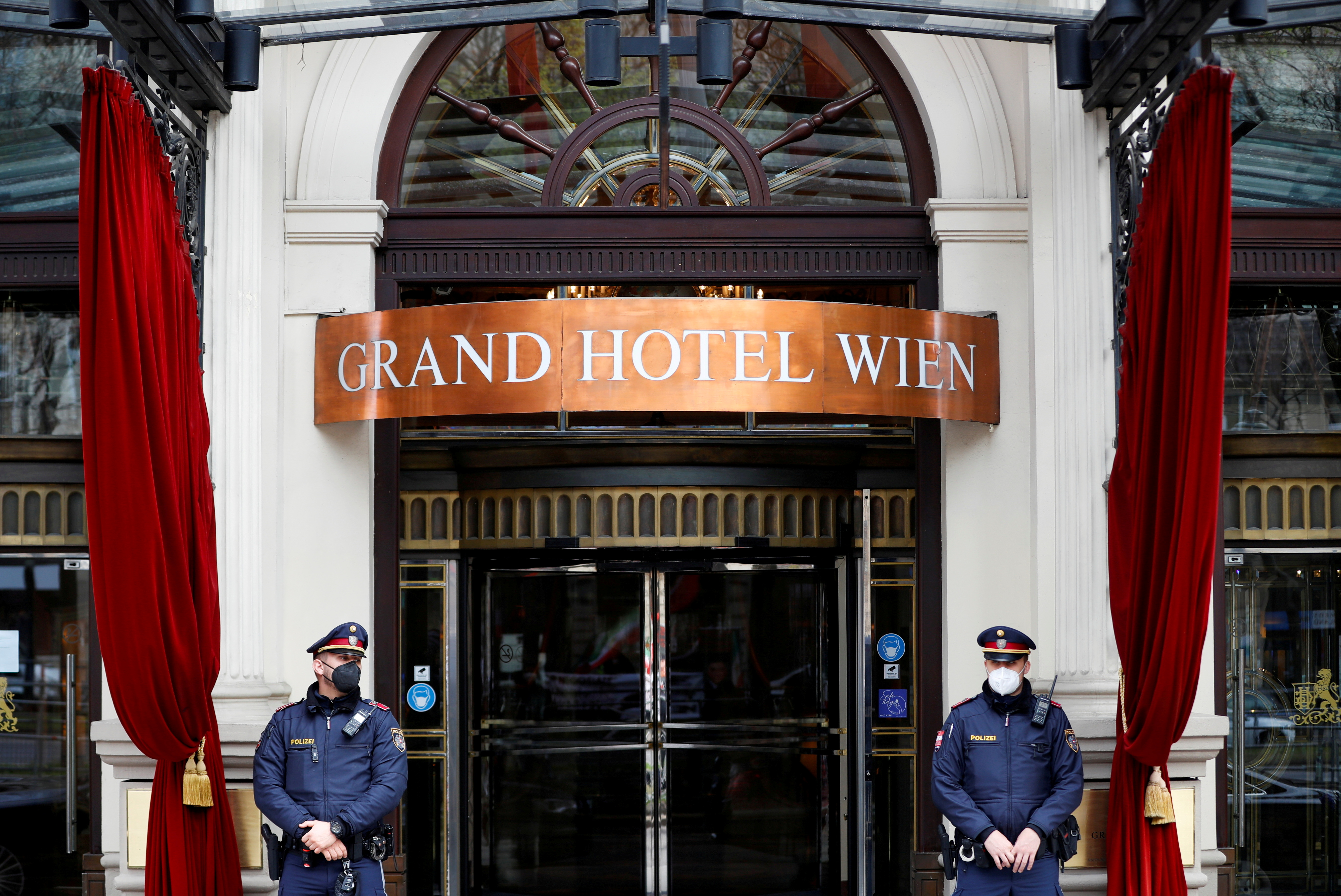 Police stand outside a hotel where a meeting of the Joint Commission of the Joint Comprehensive Plan of Action (JCPOA), or Iran nuclear deal, is held in Vienna, Austria, April 20, 2021. REUTERS/Leonhard Foeger
