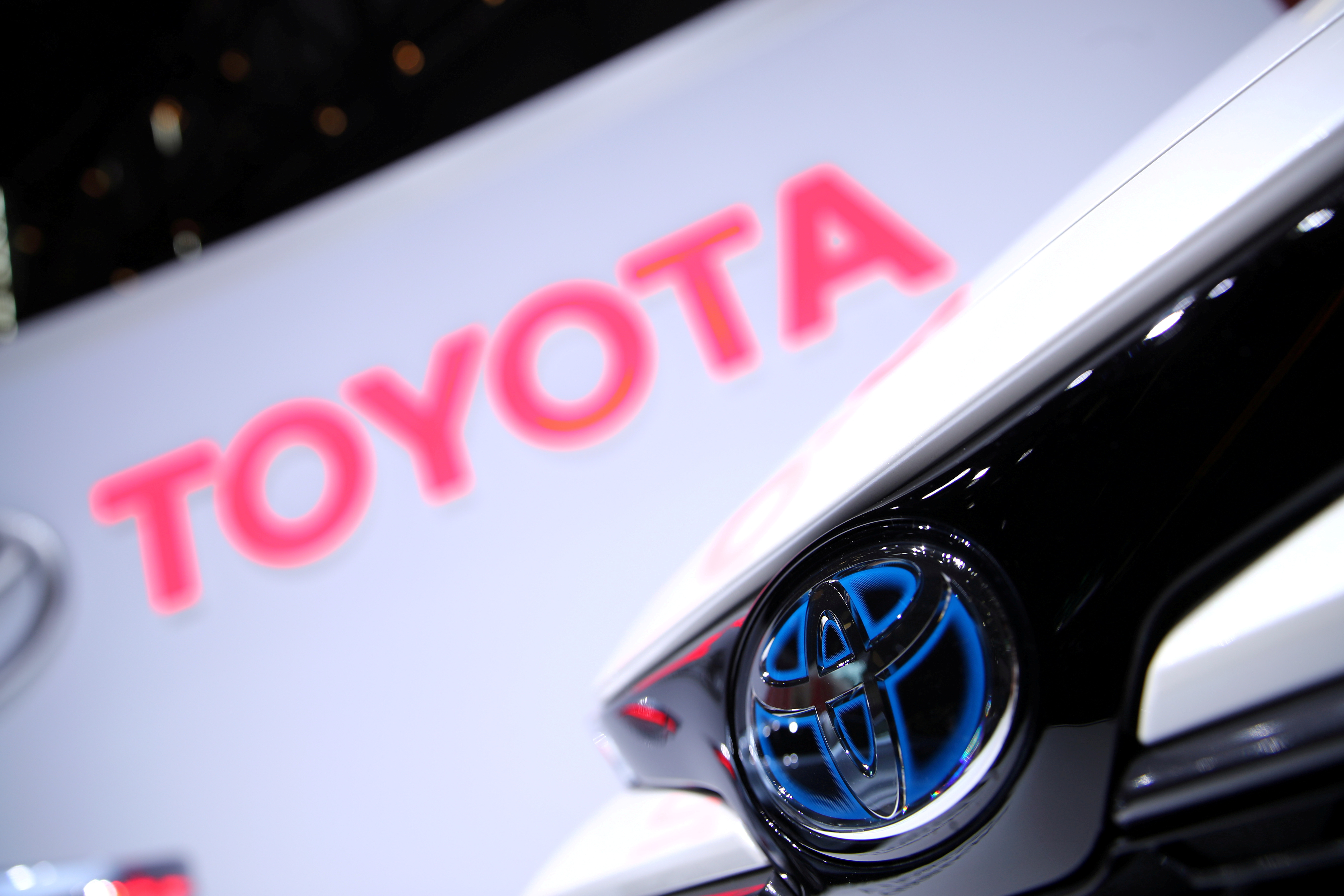 The Toyota logo is seen on a Corolla model at the 89th Geneva International Motor Show in Geneva, Switzerland March 5, 2019. REUTERS/Denis Balibouse/File Photo