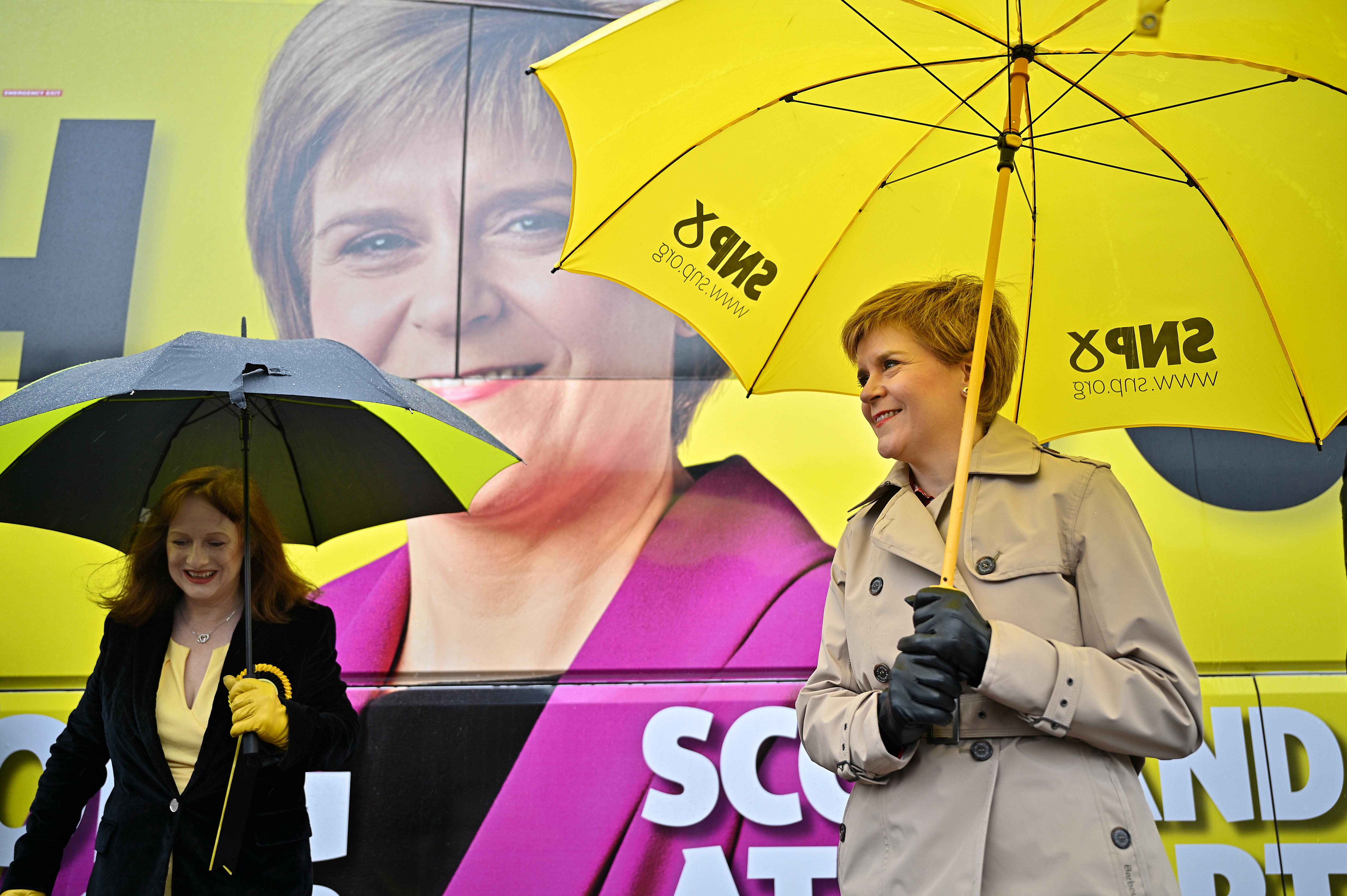 Scotland's First Minister Nicola Sturgeon and Joan McAlpine campaign in Midsteeple Quarter for the Scottish Parliament election, in Dumfries, Scotland, Britain May 3, 2021.  Jeff J Mitchell/Pool via REUTERS