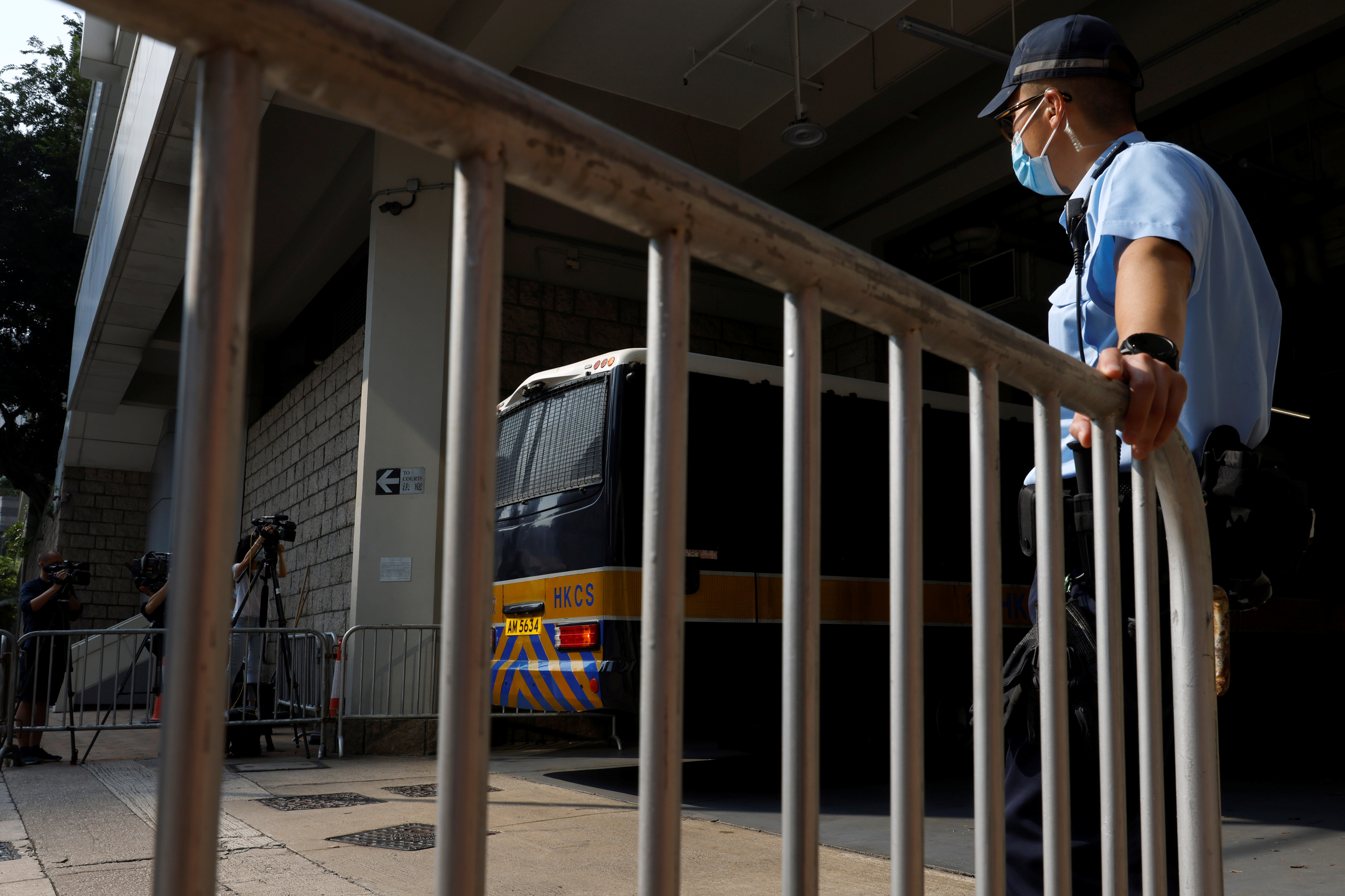 A prison van which is carrying Tong Ying-kit, the first person charged under the new national security law, arrives at High Court for a hearing, in Hong Kong, China July 27, 2021. REUTERS/Tyrone Siu