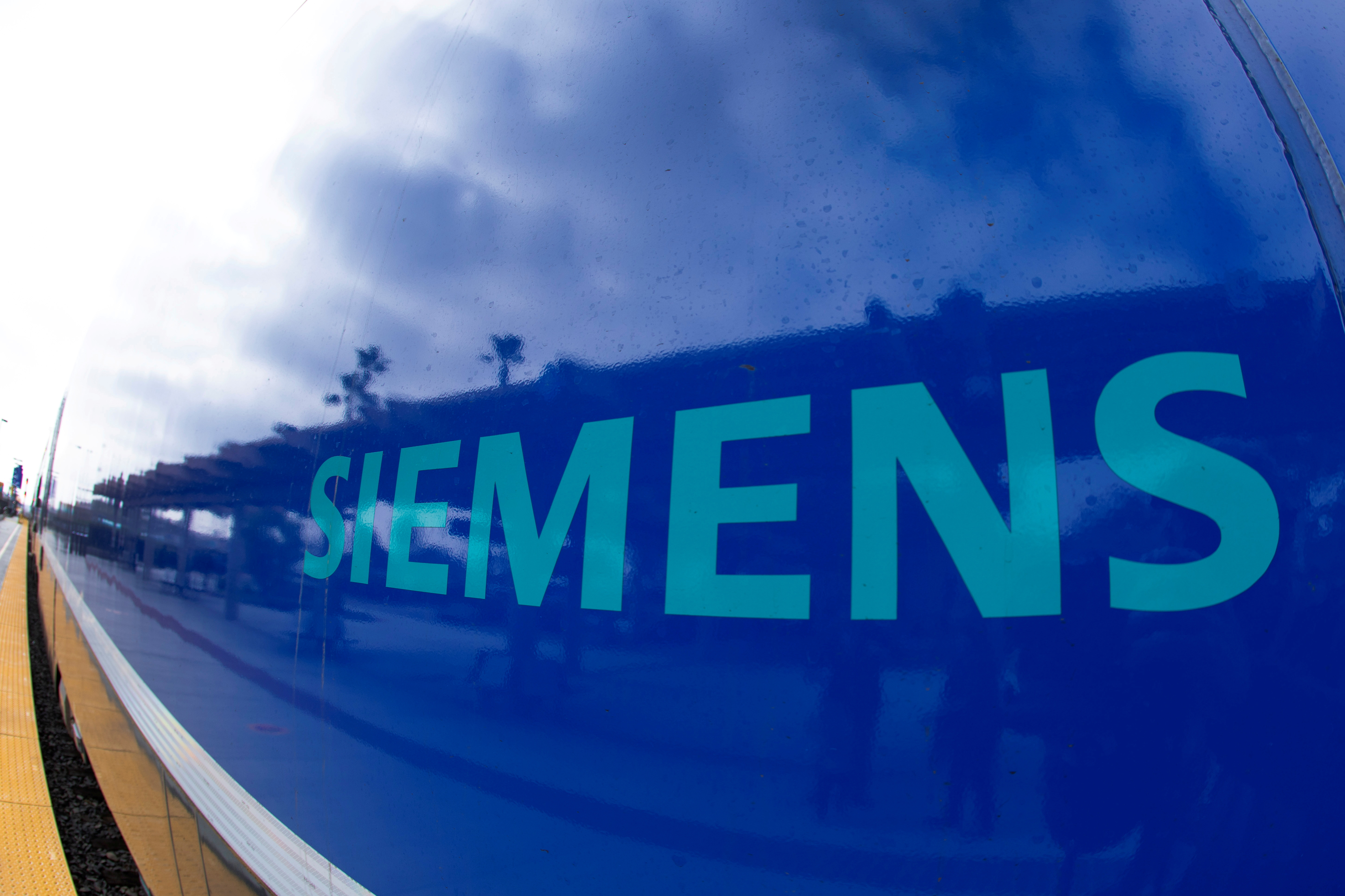 The Siemens logo is shown on a new Siemens Charger locomotive as it comes into service as part of the Coaster Fleet in Oceanside, California, U.S., February 8, 2021. REUTERS/Mike Blake/File Photo