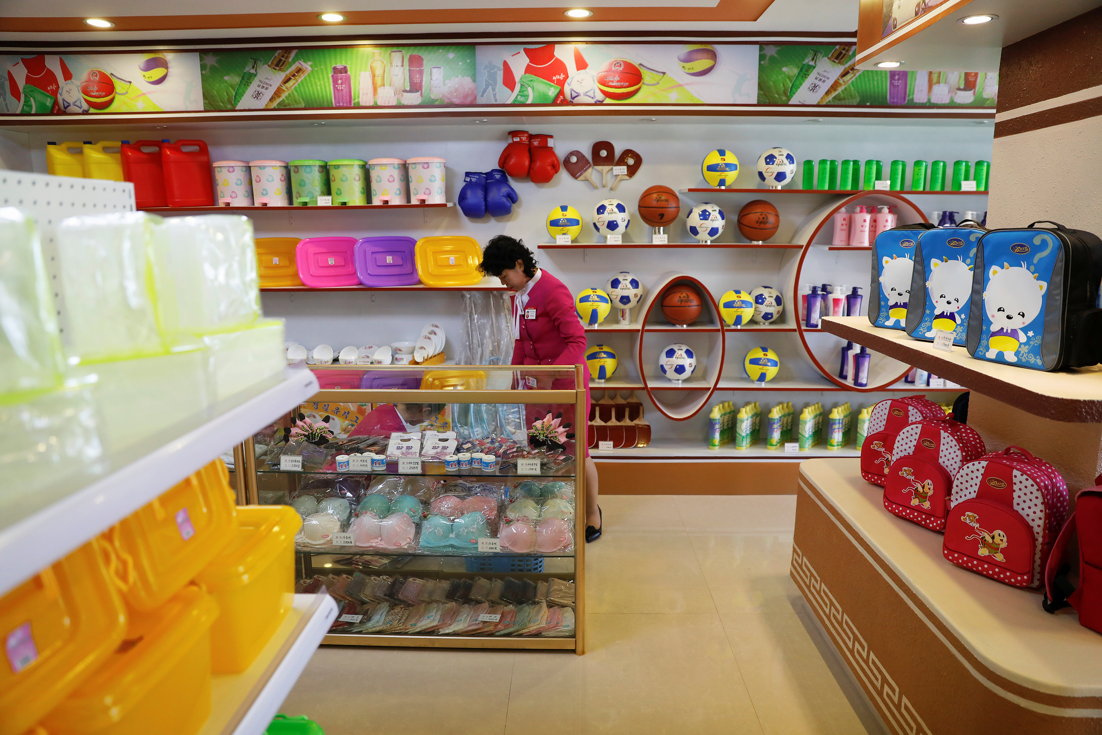 A vendor is pictured in a shop in a newly constructed residential complex after its opening ceremony in Ryomyong street in Pyongyang, North Korea April 13, 2017. REUTERS/Damir Sagolj