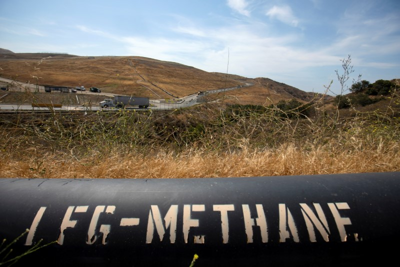 A pipeline that moves methane gas from the Frank R. Bowerman landfill to an onsite power plant is shown in Irvine, California, California, U.S., June 15, 2021. REUTERS/Mike Blake