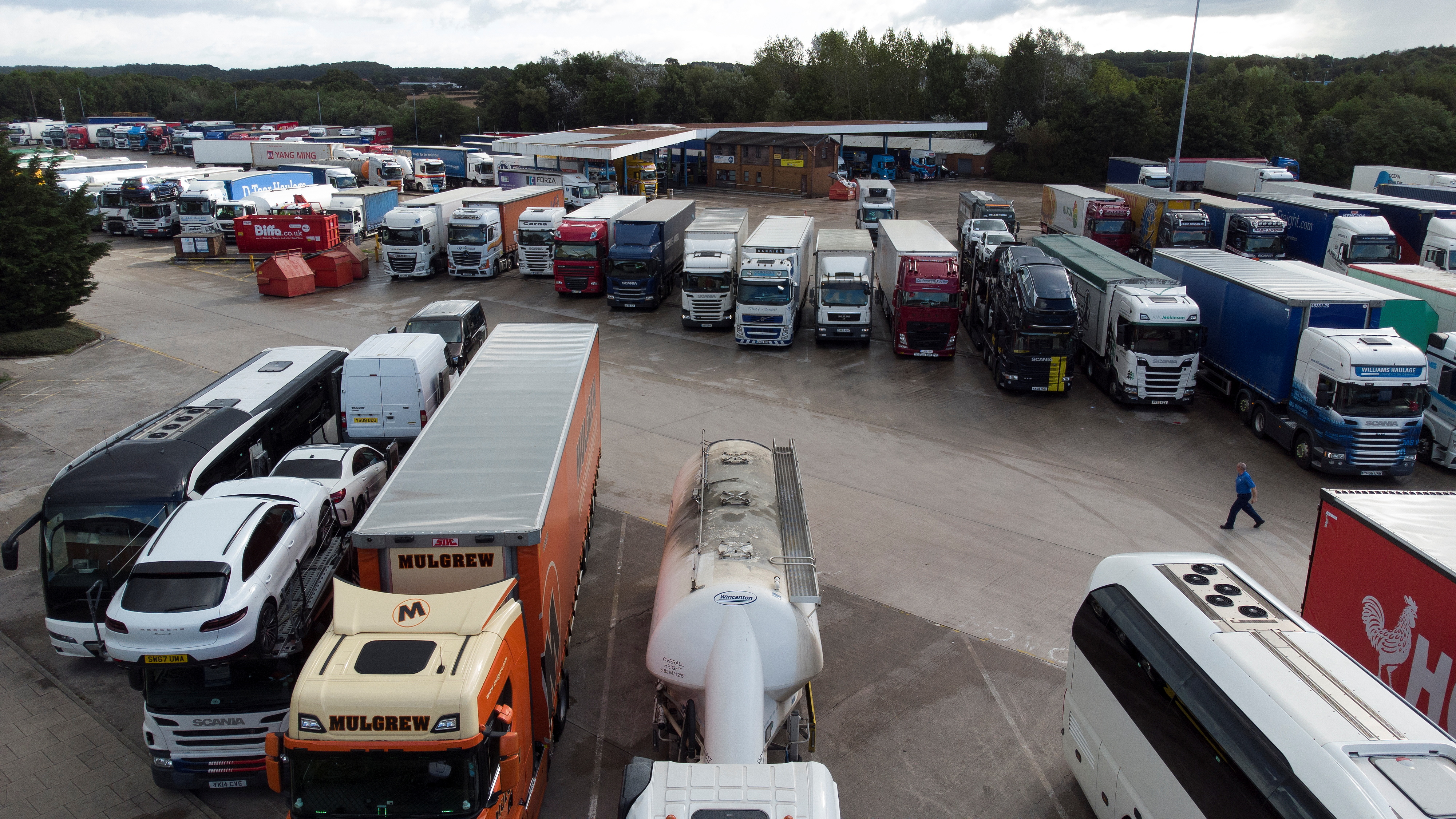 Lorries are seen at Lymm Services, Lymm, Britain, September 29, 2021. Picture taken with a drone. REUTERS/Jason Cairnduff