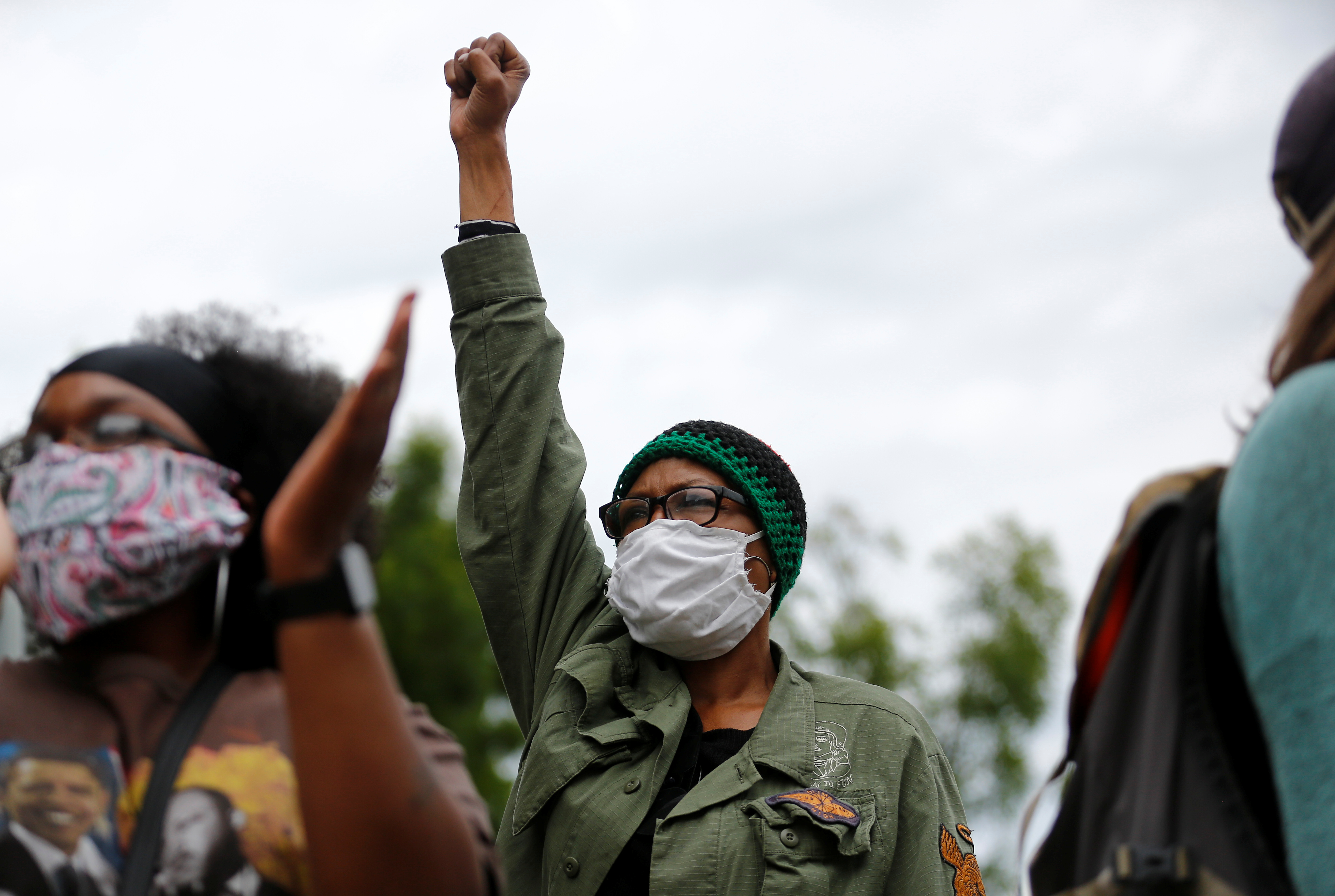 Tamu Simmons, 64, holds her fist in the air as protesters rally following the death of Manuel Ellis in Tacoma police custody in March, and the death of George Floyd in Minneapolis police custody, in Tacoma, Washington, U.S. June 5, 2020. REUTERS/Lindsey Wasson