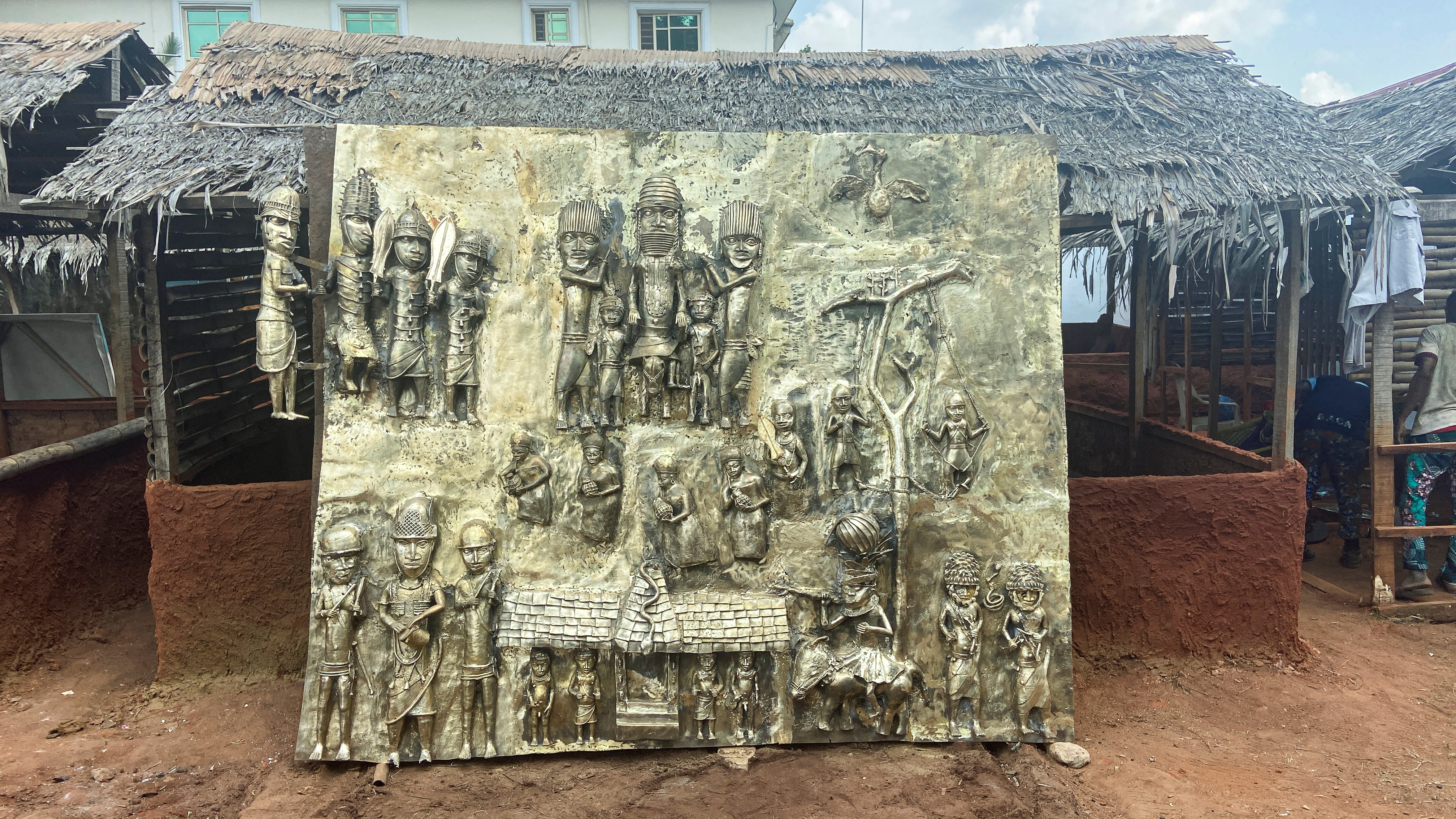 A newly made bronze plaque depicting historical events in West Africa's once mighty Kingdom of Benin, which is being offered as a gift to the British Museum, is seen on display in Benin City, Nigeria, July 31, 2021. REUTERS/Tife Owolabi