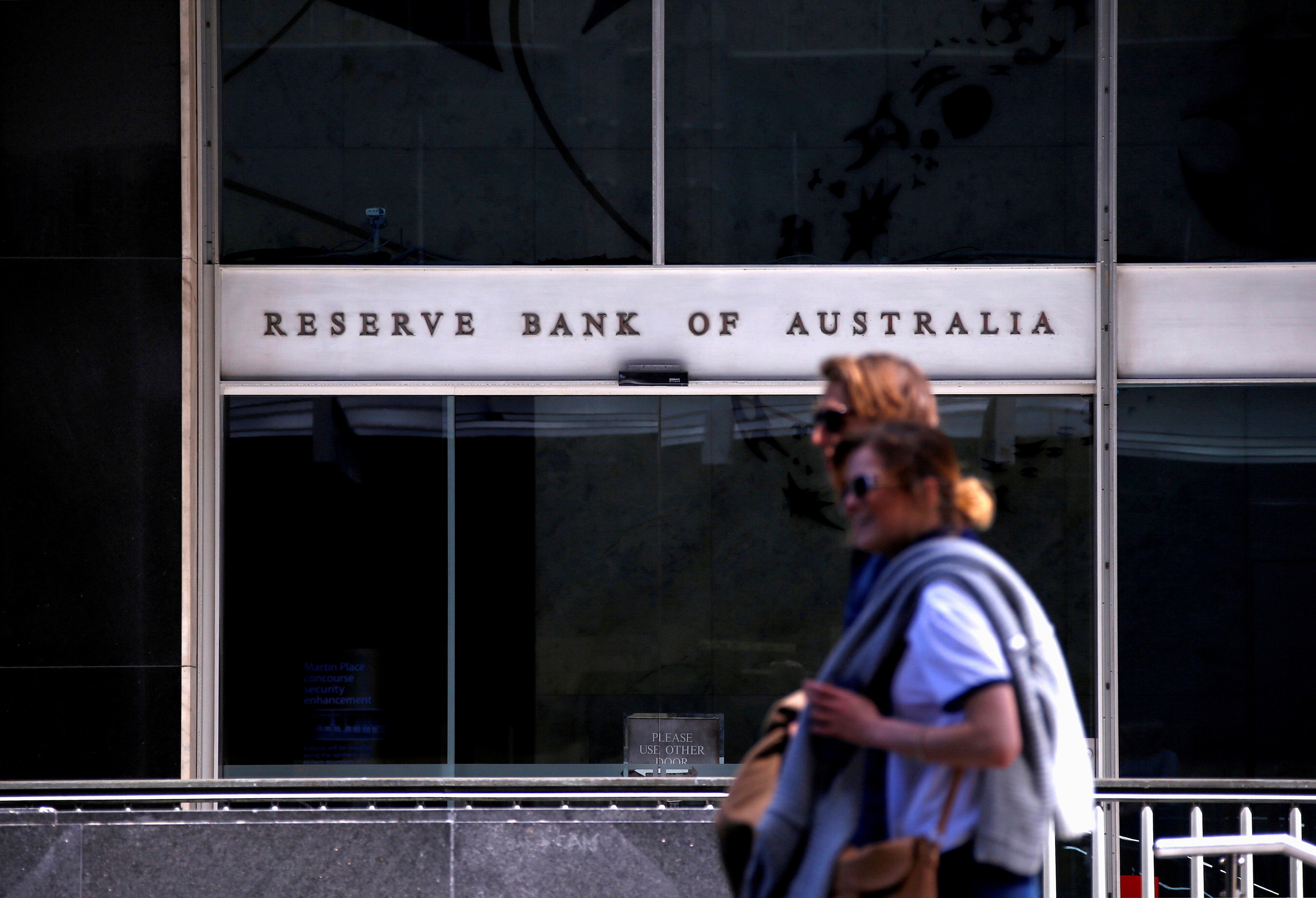 Pedestrians walk past the main entrance to the Reserve Bank of Australia (RBA) head office in central Sydney, Australia, October 3, 2016. Picture taken October 3, 2016. REUTERS/David Gray/File Photo