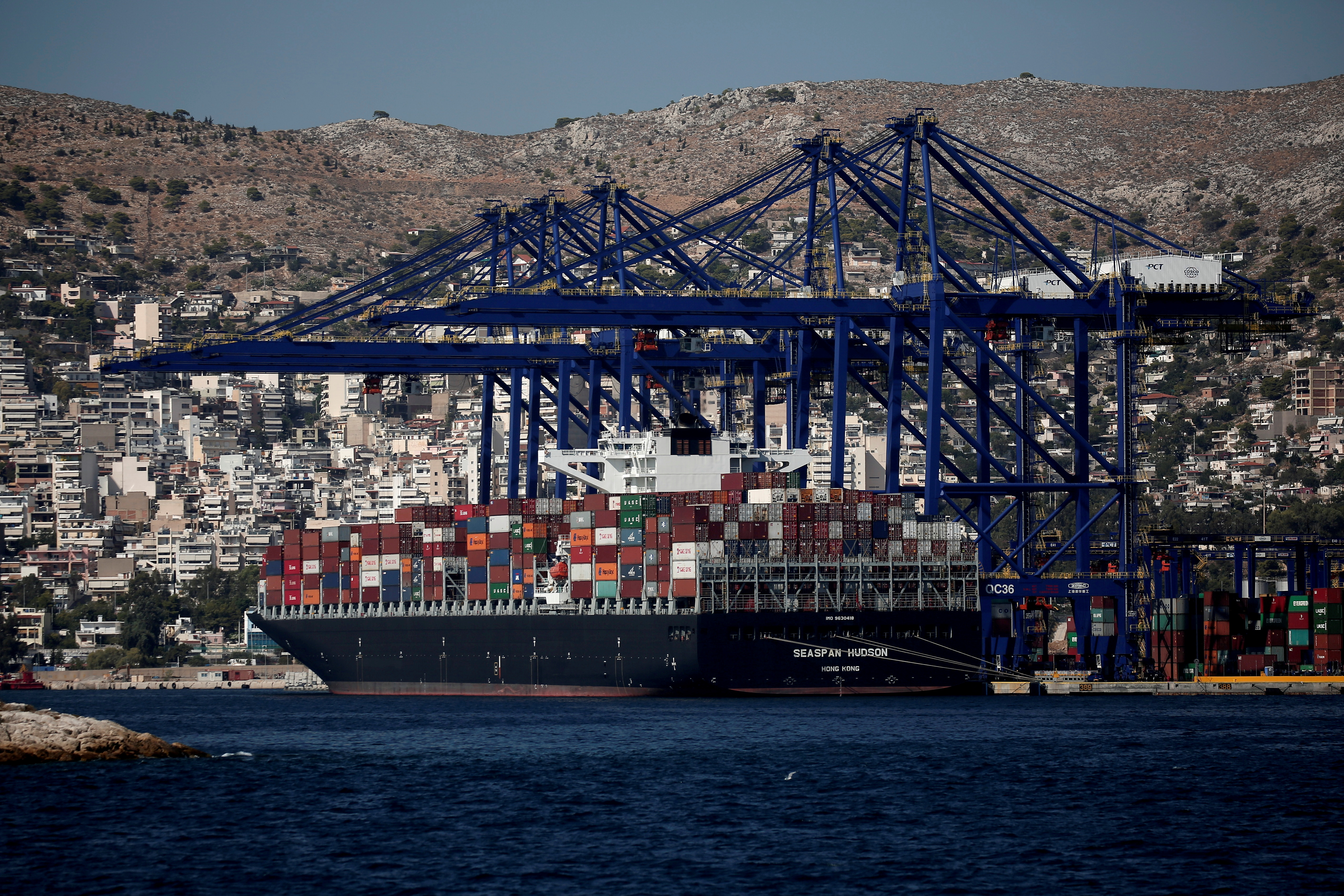A cargo ship is moored at the Piraeus Container Terminal, near Athens, Greece, September 20, 2017. REUTERS/Alkis Konstantinidis/File Photo