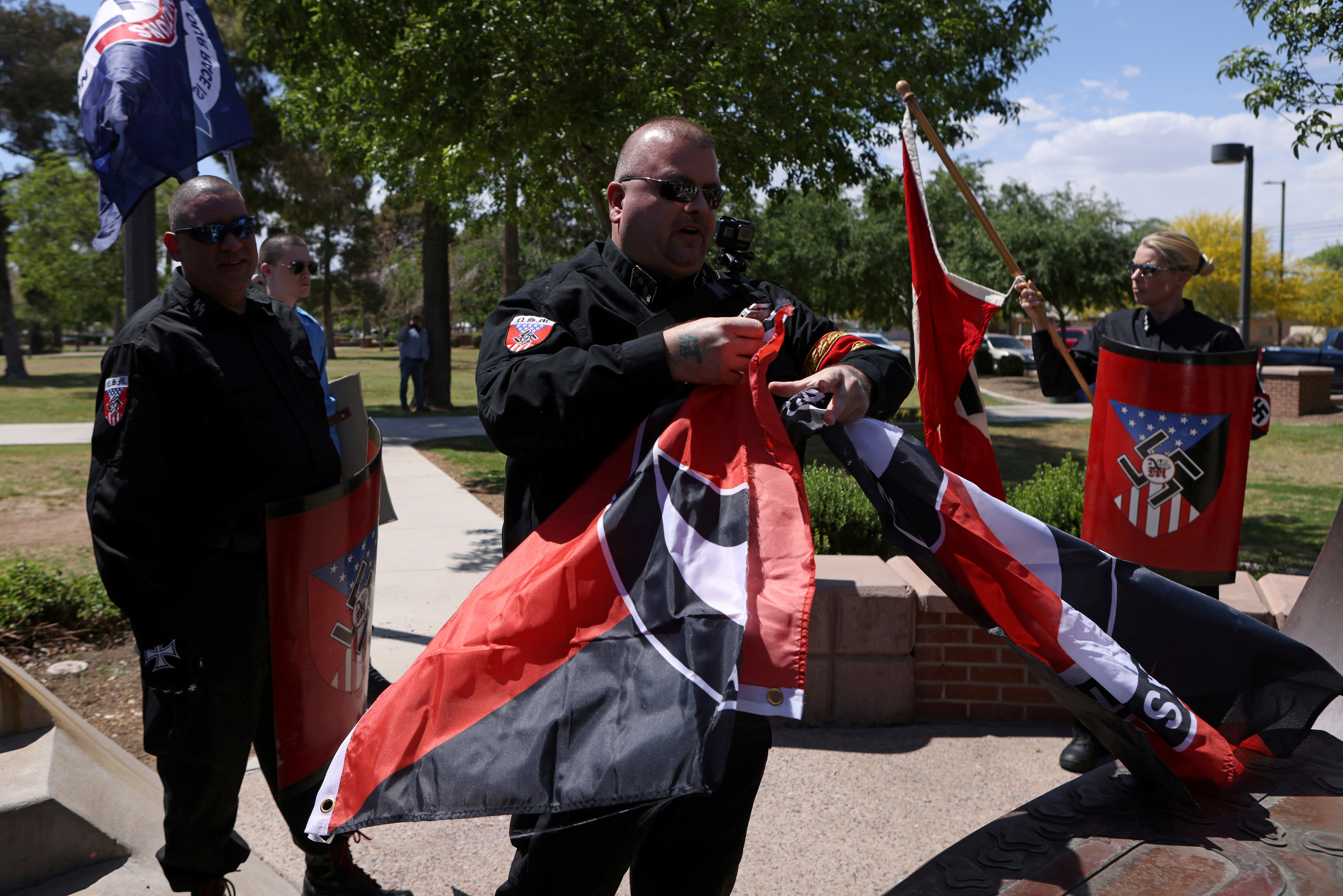 Burt Colucci of the white nationalist group National Socialist Movement destroys a flag of the anti-facist movement during a rally in Phoenix, Arizona, U.S., April 17, 2021. Picture taken April 17, 2021. REUTERS/Jim Urquhart/File Photo