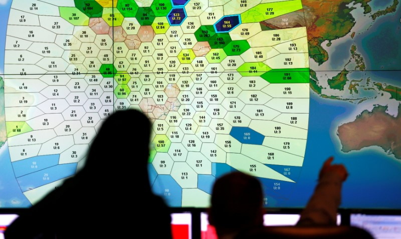 Staff at satellite communications company Inmarsat work in front of a screen showing subscribers using their service throughout the world, at their headquarters in London March 25, 2014.  REUTERS/Andrew Winning/File Photo
