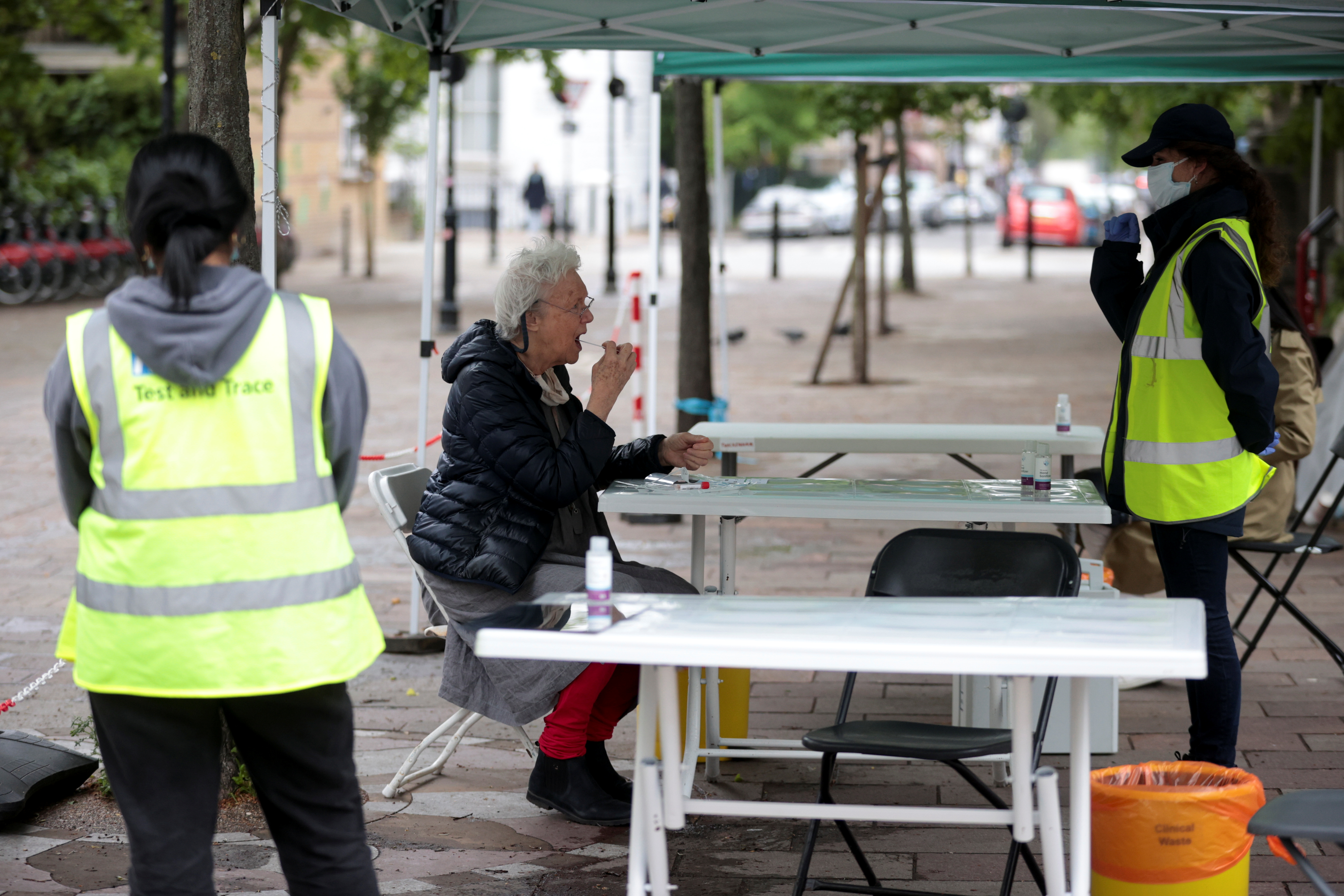 A person takes a swab sample for the coronavirus disease (COVID-19) at a surge testing site in London, Britain, May 14, 2021. REUTERS/Hannah McKay