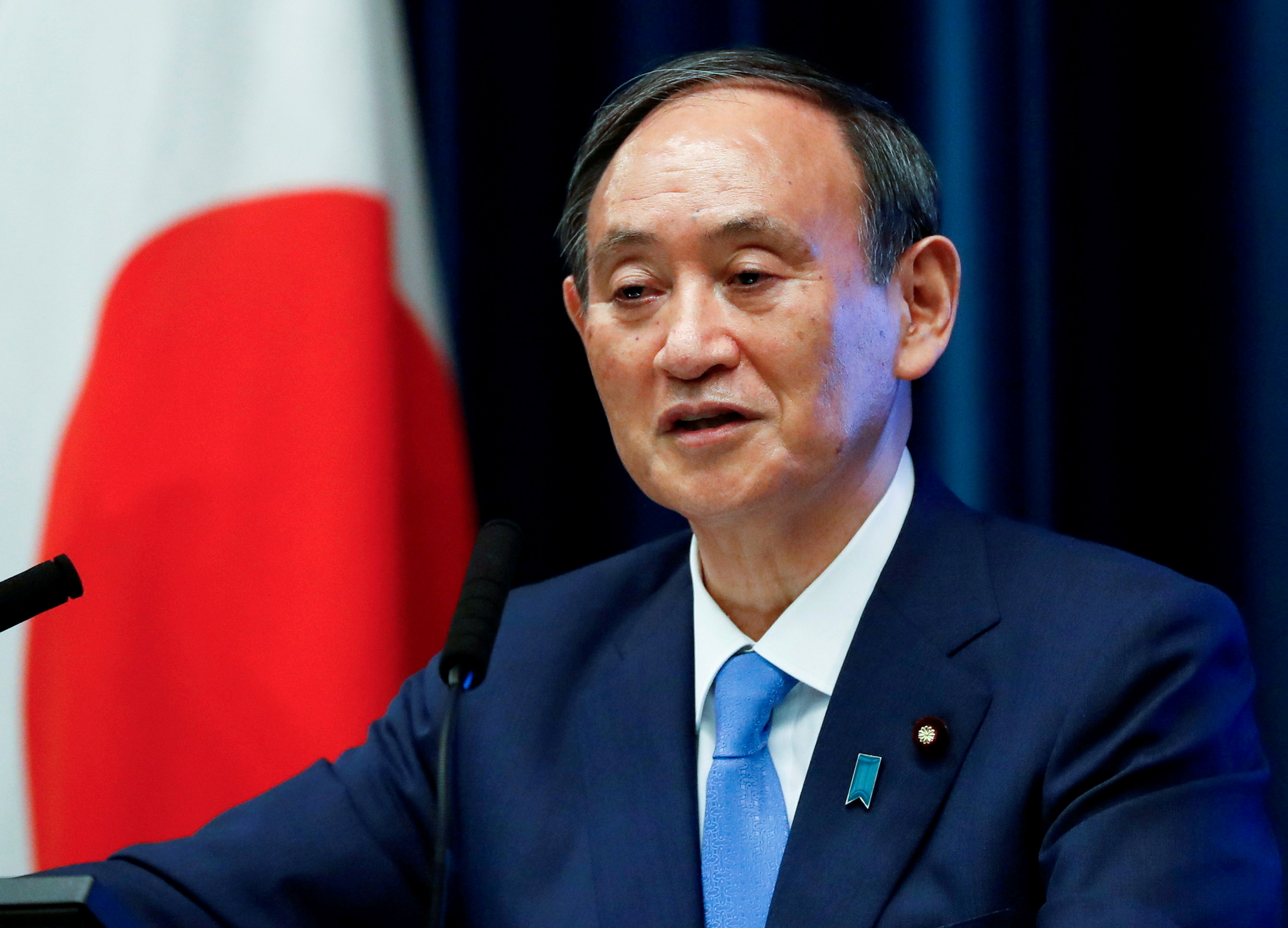 Japan's Prime Minister Yoshihide Suga attends a news conference on Japan's response to the coronavirus disease (COVID-19) outbreak, at his official residence in Tokyo, Japan, June 17, 2021. REUTERS/Issei Kato/File Photo