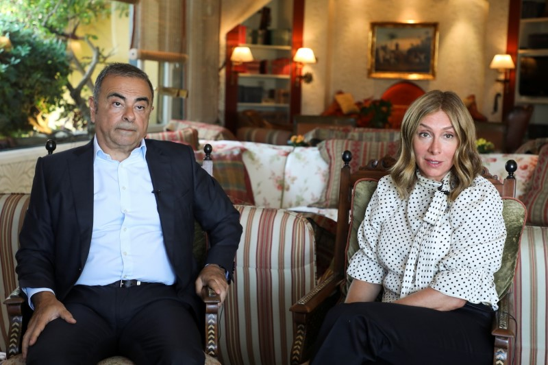 Fugitive former car executive Carlos Ghosn, and his wife Carole Ghosn, talk during an interview with Reuters in Beirut, Lebanon June 14, 2021. REUTERS/Mohamed Azakir