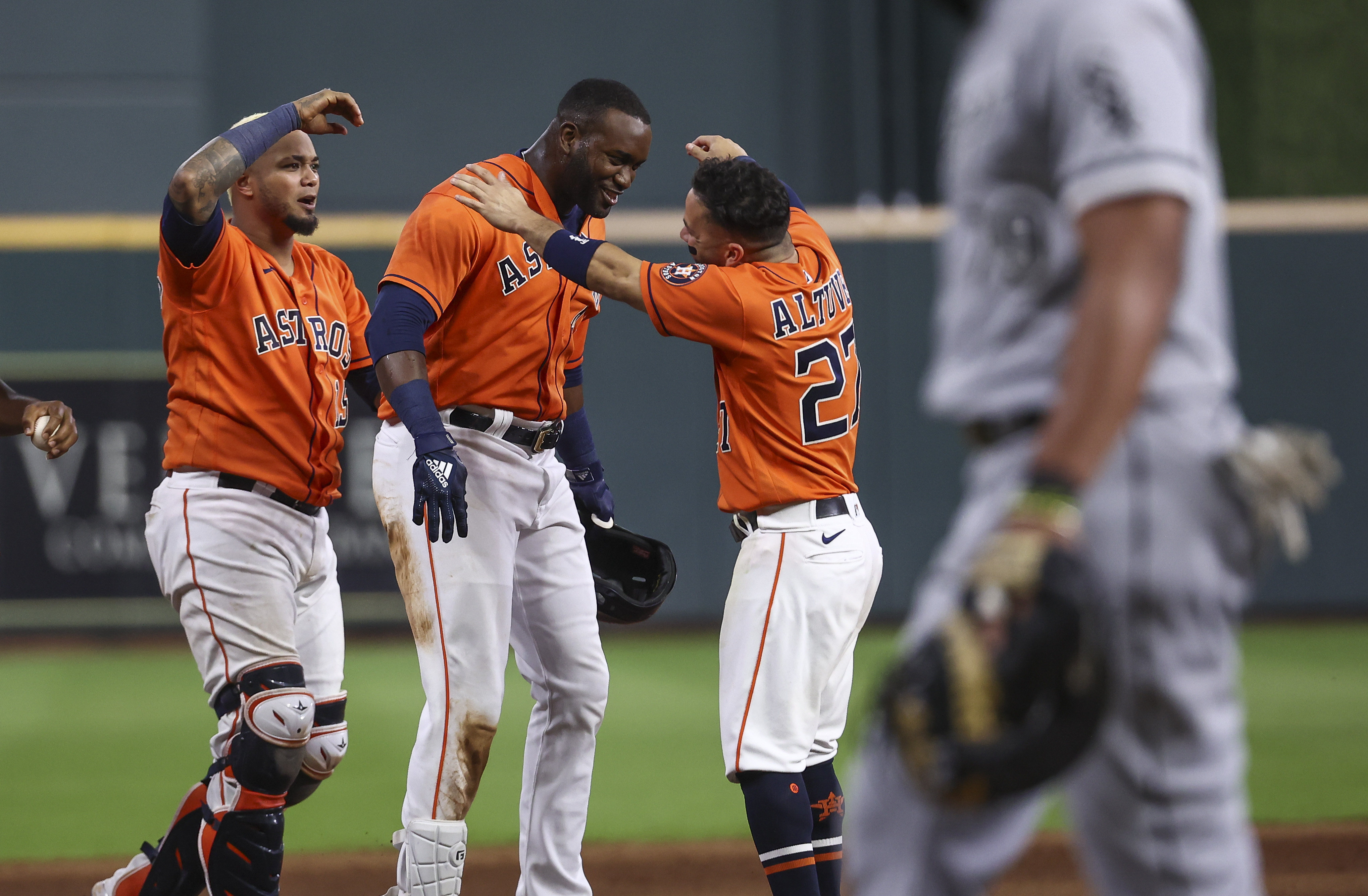 Jun 18, 2021; Houston, Texas, USA; Houston Astros designated hitter Yordan Alvarez (44) celebrates with teammates after driving in a run during the ninth inning against the Chicago White Sox at Minute Maid Park. Mandatory Credit: Troy Taormina-USA TODAY Sports