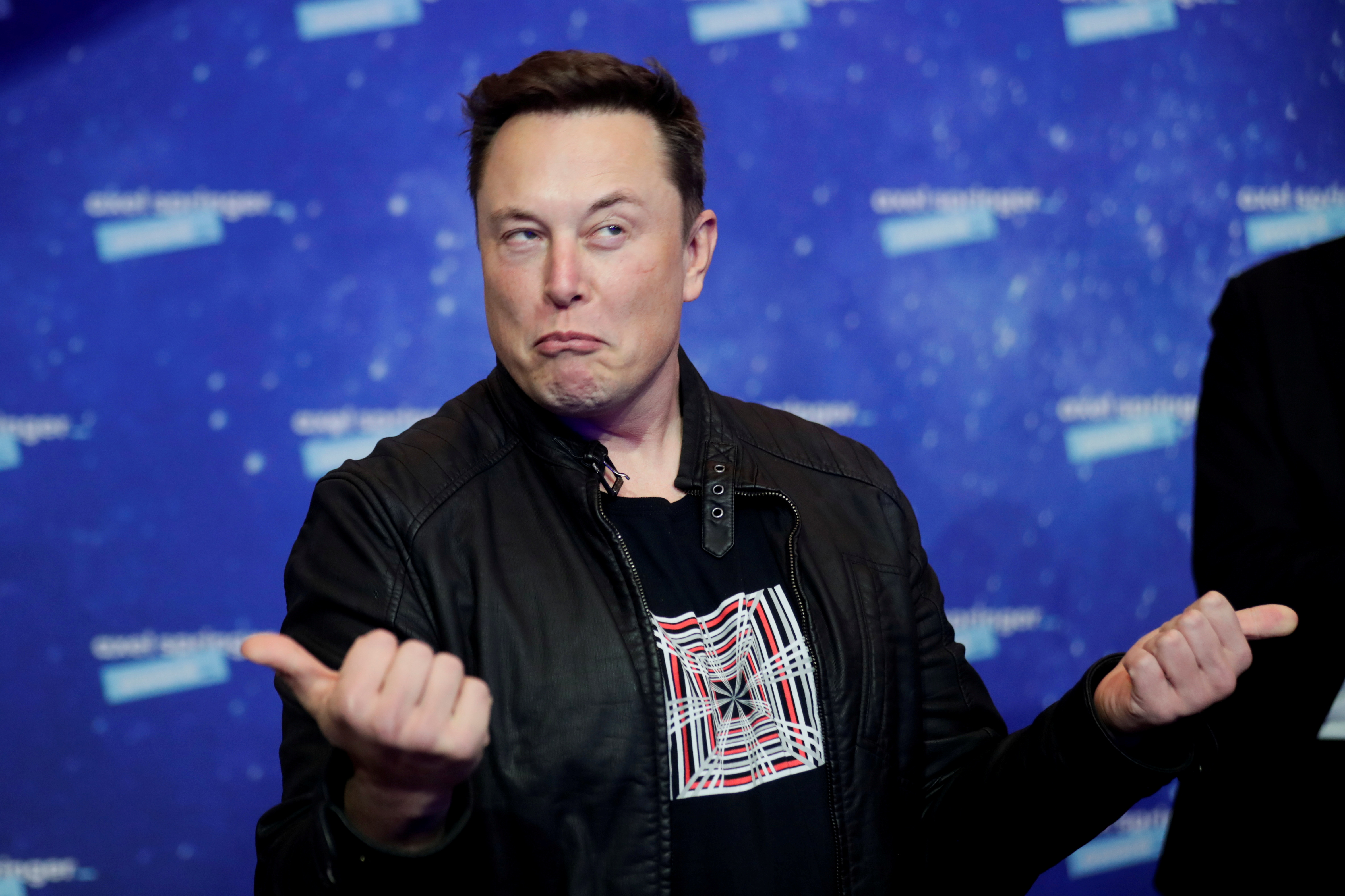 SpaceX owner and Tesla CEO Elon Musk grimaces after arriving on the red carpet for the Axel Springer award, in Berlin, Germany, December 1, 2020. REUTERS/Hannibal Hanschke/Pool/File Photo