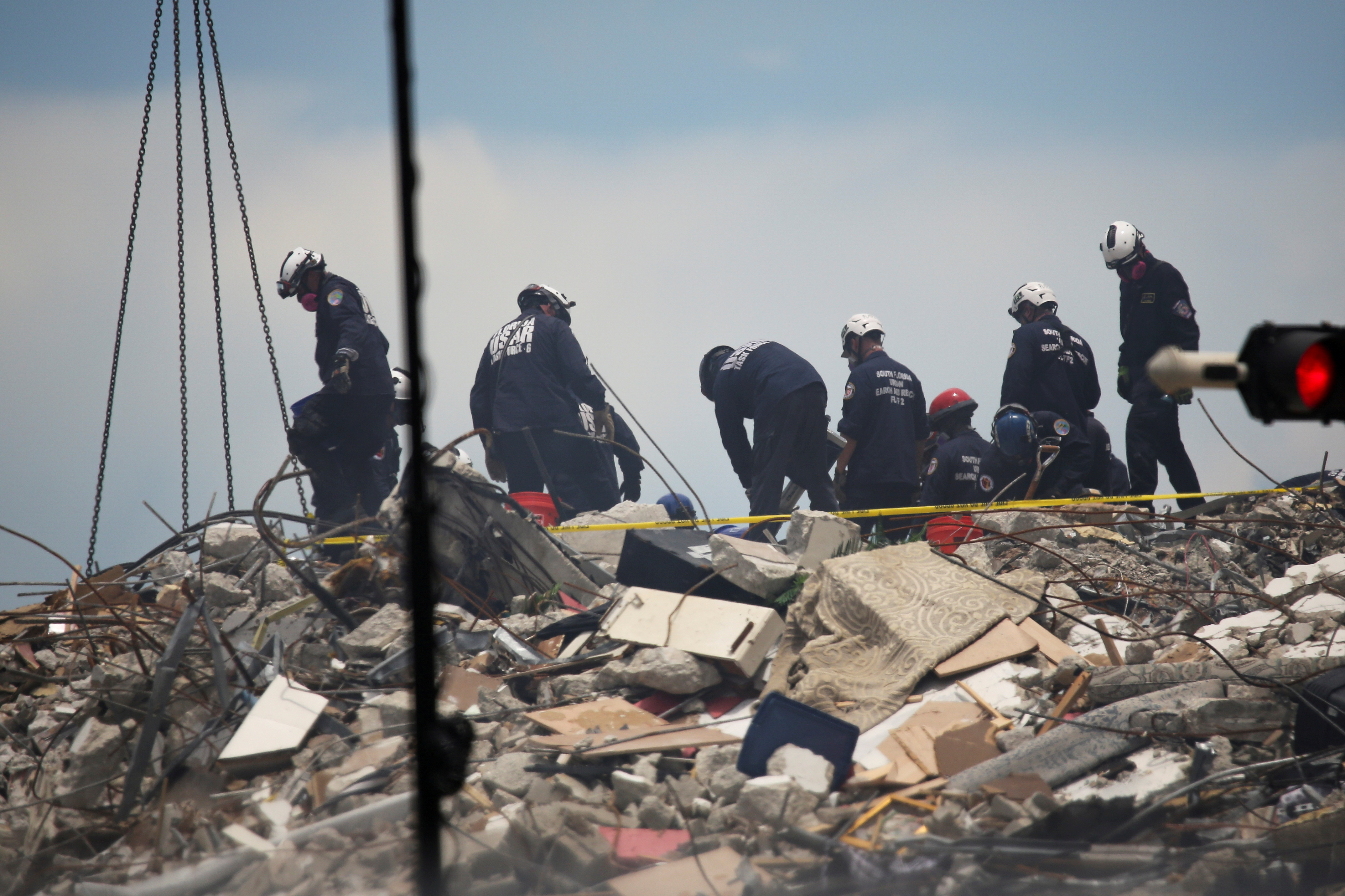 Rescue personnel continue search and rescue operations for survivors of a partially collapsed residential building in Surfside, near Miami Beach, Florida, June 26, 2021. REUTERS/Marco Bello/File Photo