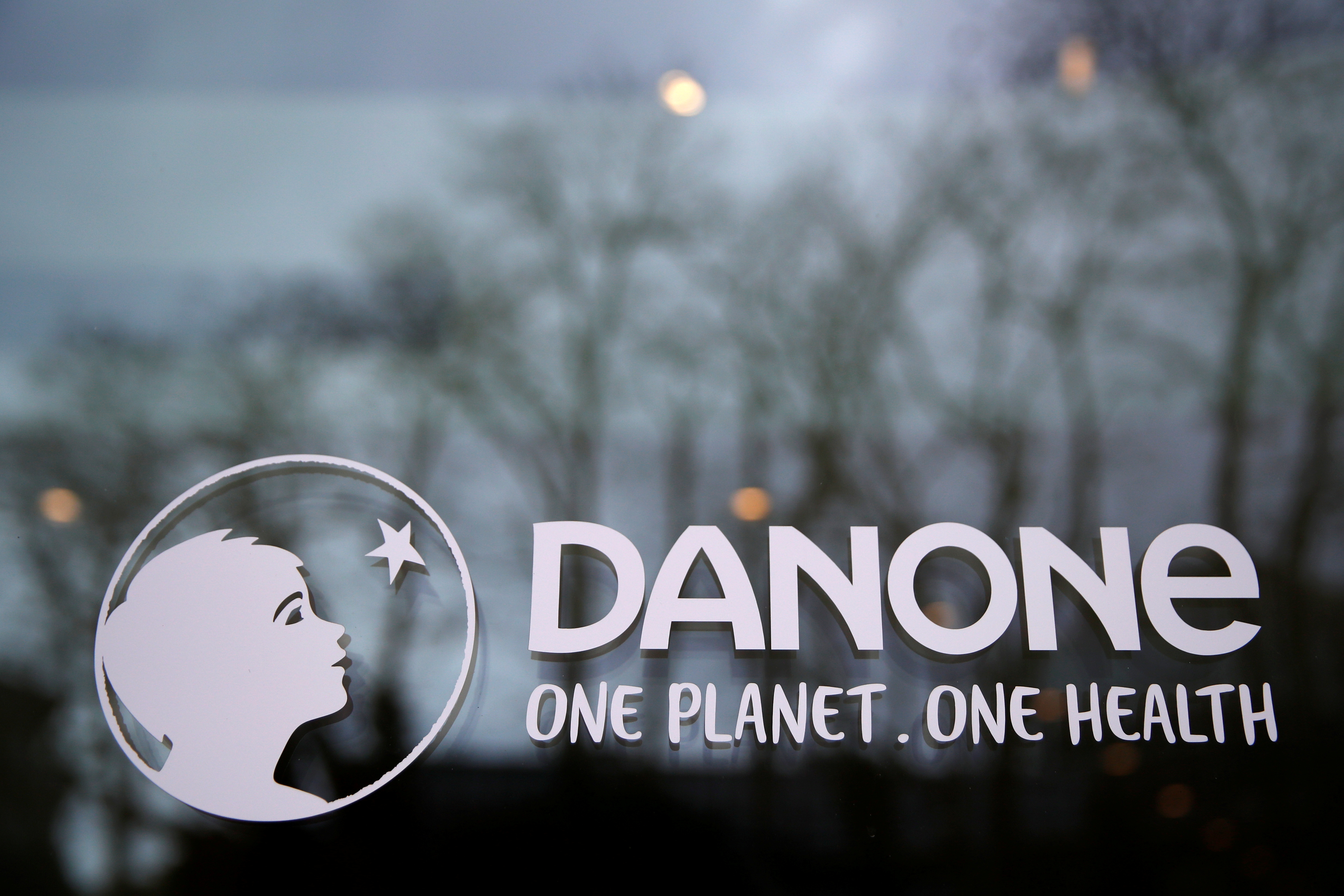 French food group Danone logo is seen at the company headquarters in Rueil-Malmaison near Paris, France, February 18, 2021. REUTERS/Gonzalo Fuentes