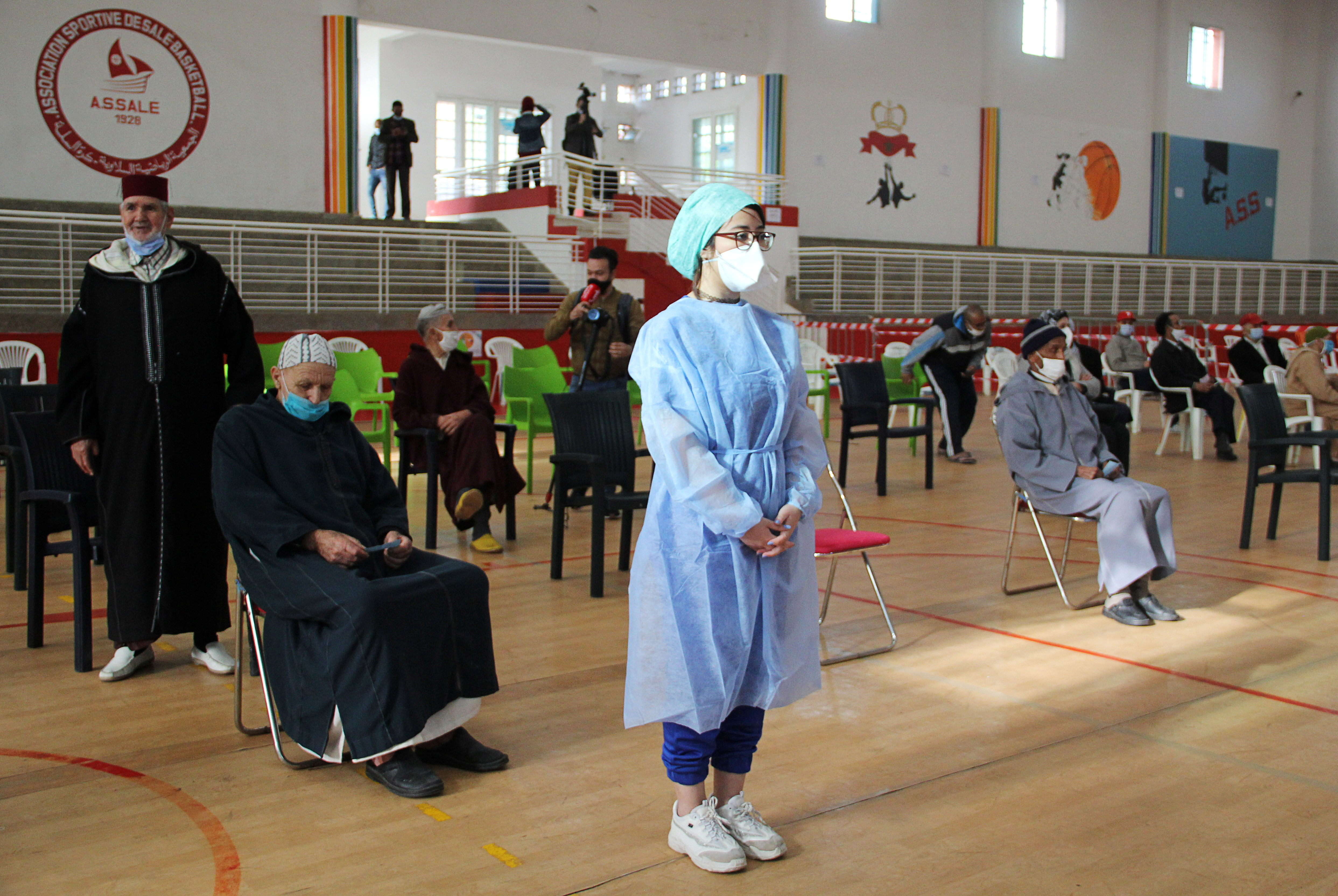People wait to receive the COVID-19 vaccine, during a national coronavirus vaccination campaign, in Sale, Morocco January 29, 2021.  REUTERS/Shereen Talaat