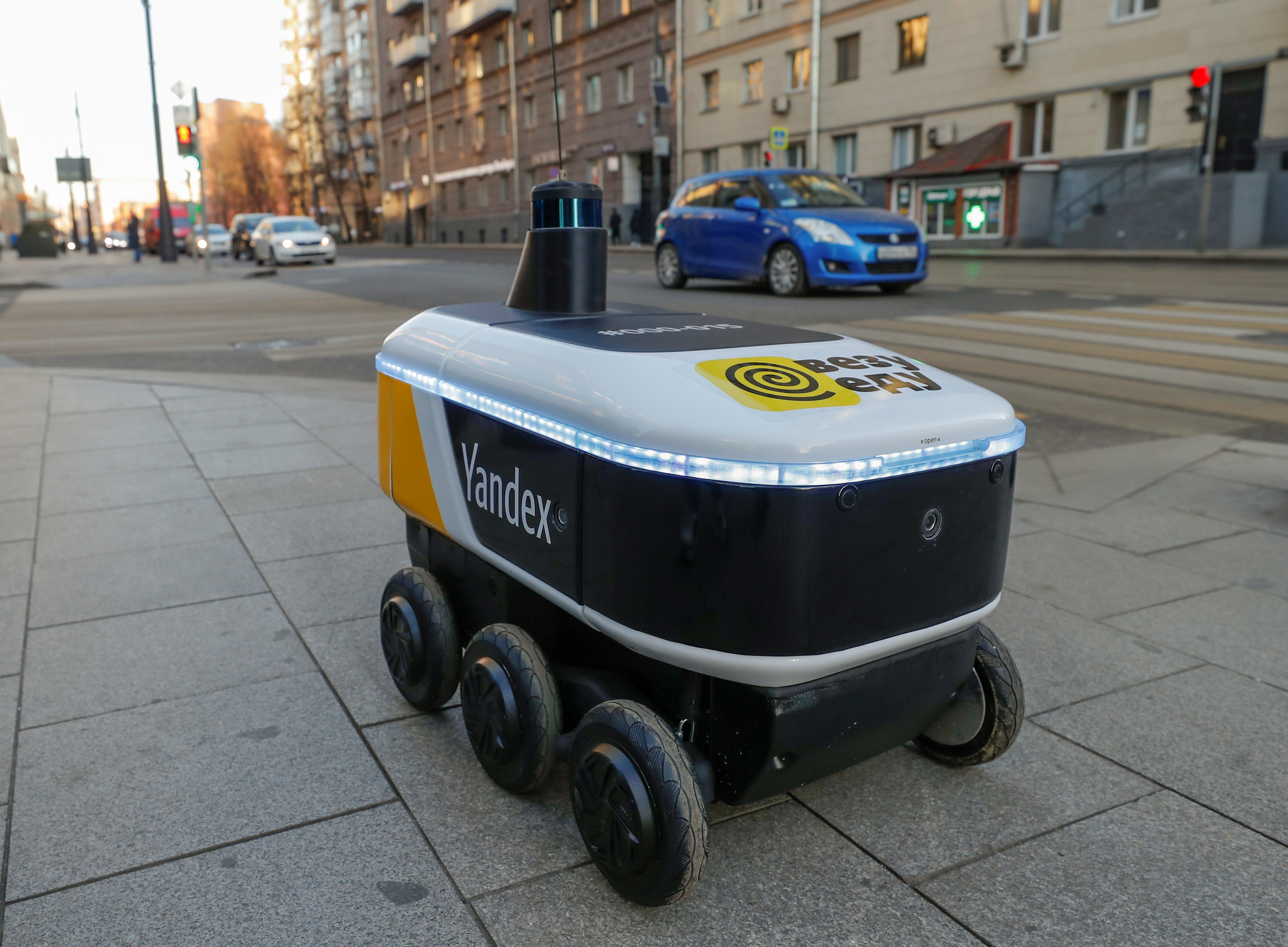 Yandex.Rover, a driverless robot for delivering hot restaurant meals, is seen at a business district in Moscow, Russia December 10, 2020. REUTERS/Evgenia Novozhenina/File Photo