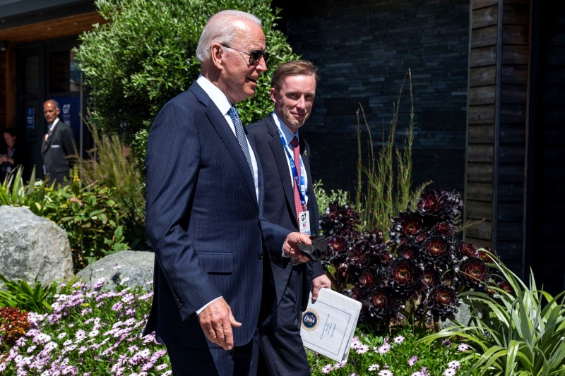 U.S. President Joe Biden walks with National Security Advisor Jake Sullivan as he arrives for the final session of the G7 summit in Carbis Bay, Cornwall, Britain, June 13, 2021. Doug Mills/Pool via REUTERS