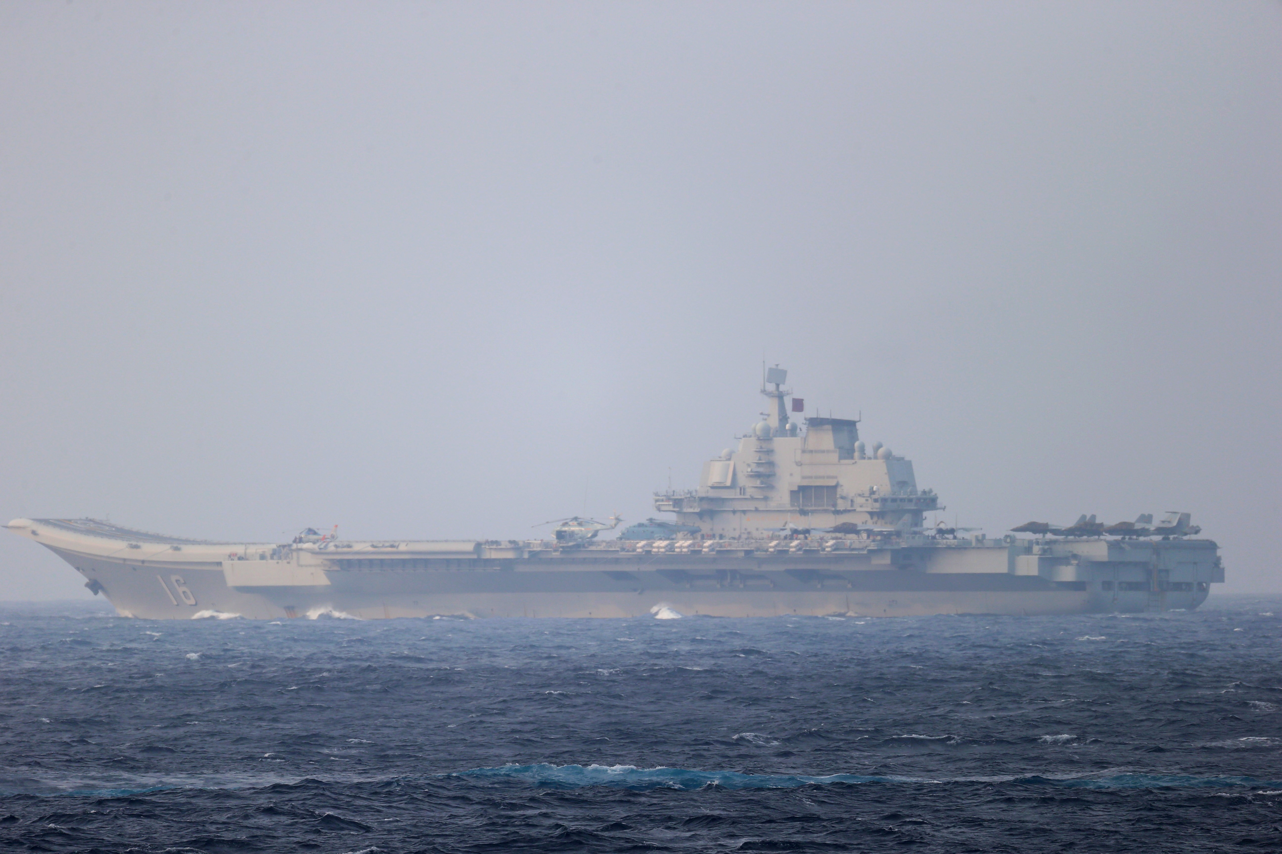 Chinese aircraft carrier Liaoning sails through the Miyako Strait near Okinawa on its way to the Pacific in this handout photo taken by Japan Self-Defense Forces and released by the Joint Staff Office of the Defense Ministry of Japan on April 4, 2021. Joint Staff Office of the Defense Ministry of Japan/HANDOUT via REUTERS