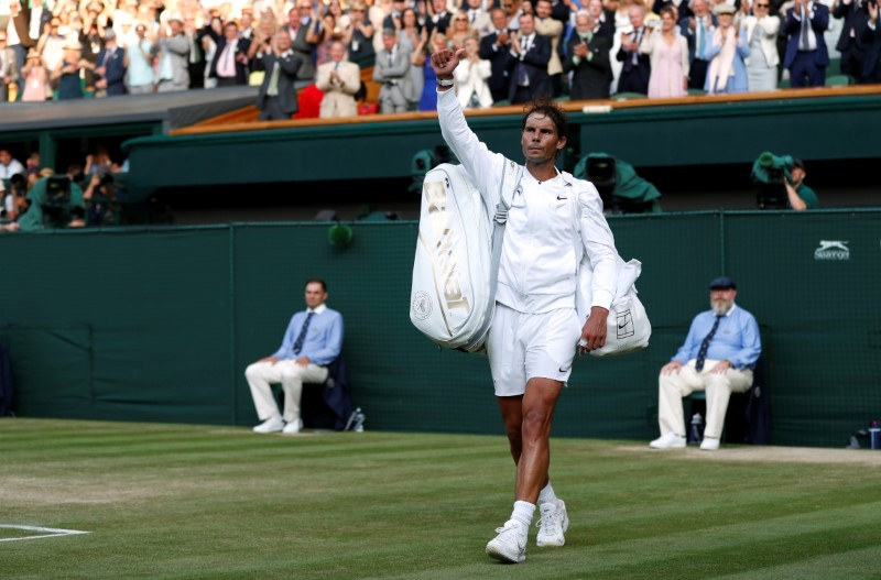 Tennis - Wimbledon - All England Lawn Tennis and Croquet Club, London, Britain - July 12, 2019  Spain's Rafael Nadal waves after losing his semi-final match against Switzerland's Roger Federer  Adrian Dennis/Pool via REUTERS
