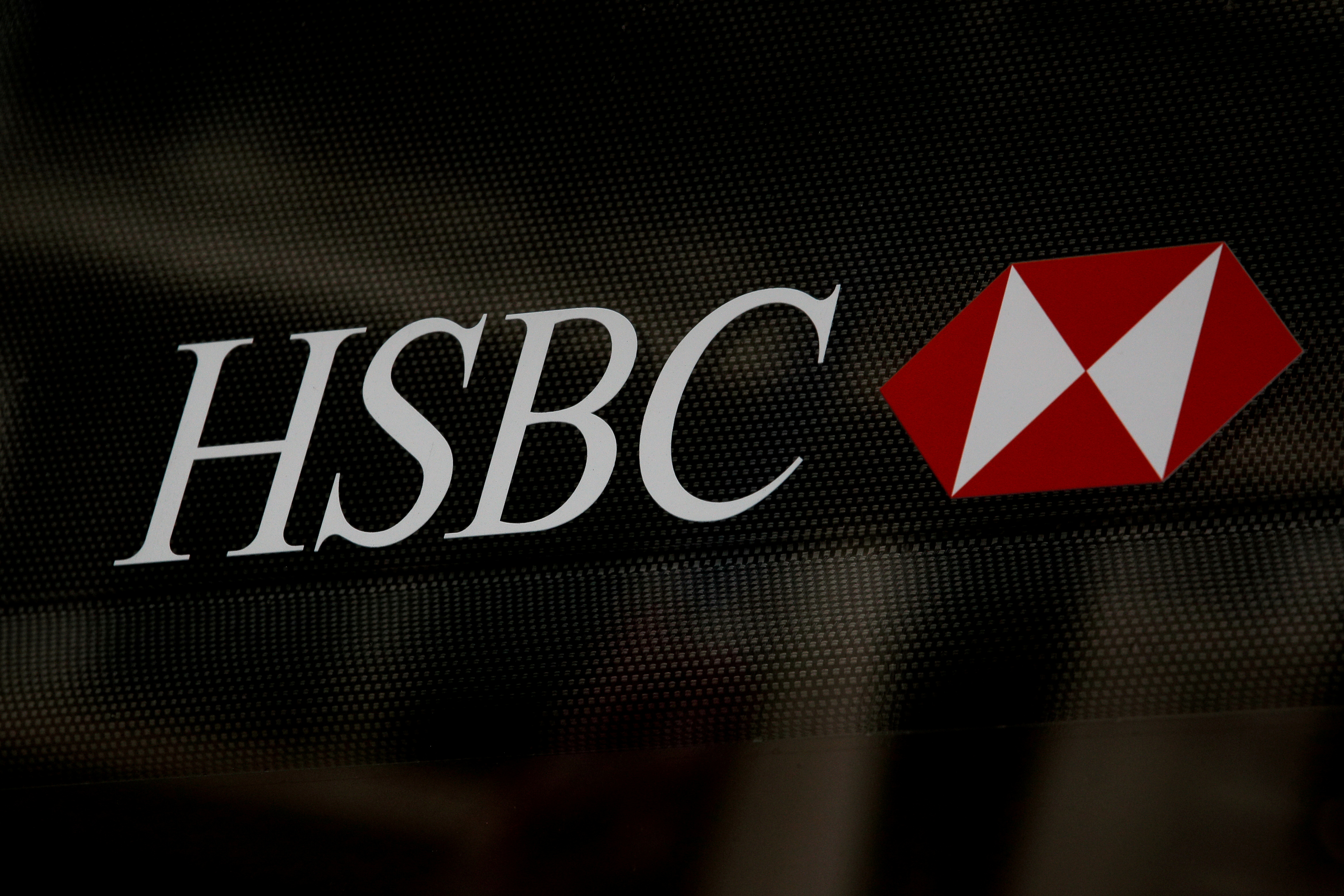 HSBC logo is seen on a branch bank in the financial district in New York, U.S., August 7, 2019. REUTERS/Brendan McDermid//File Photo