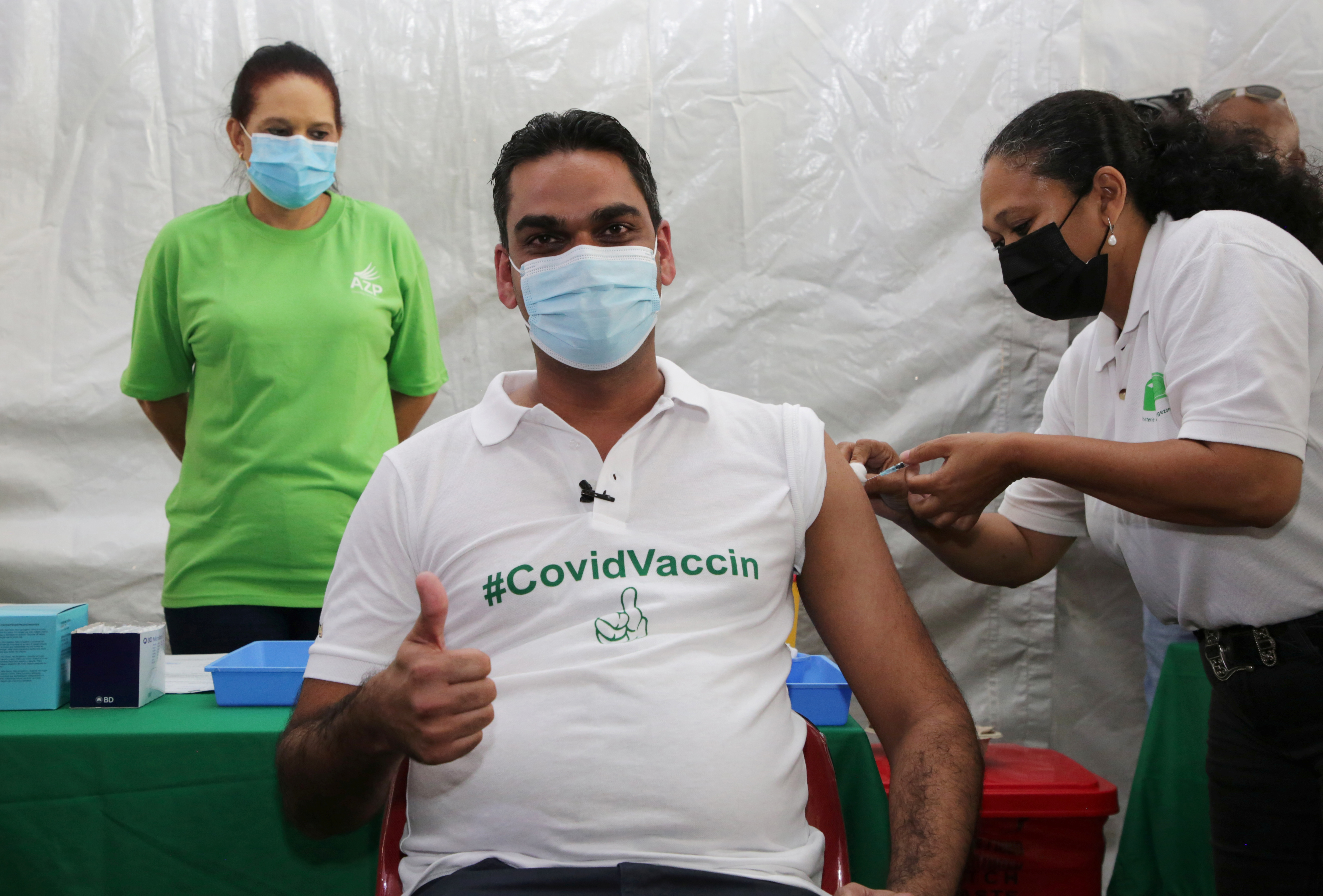 Suriname's Public Health Minister Amar Ramadhin is vaccinated with a dose of the Oxford-AstraZeneca vaccine, marketed by the Serum Institute of India (SII) as COVISHIELD, against the coronavirus disease (COVID-19), in Paramaribo, Suriname February 23, 2021. REUTERS/Ranu Abhelakh