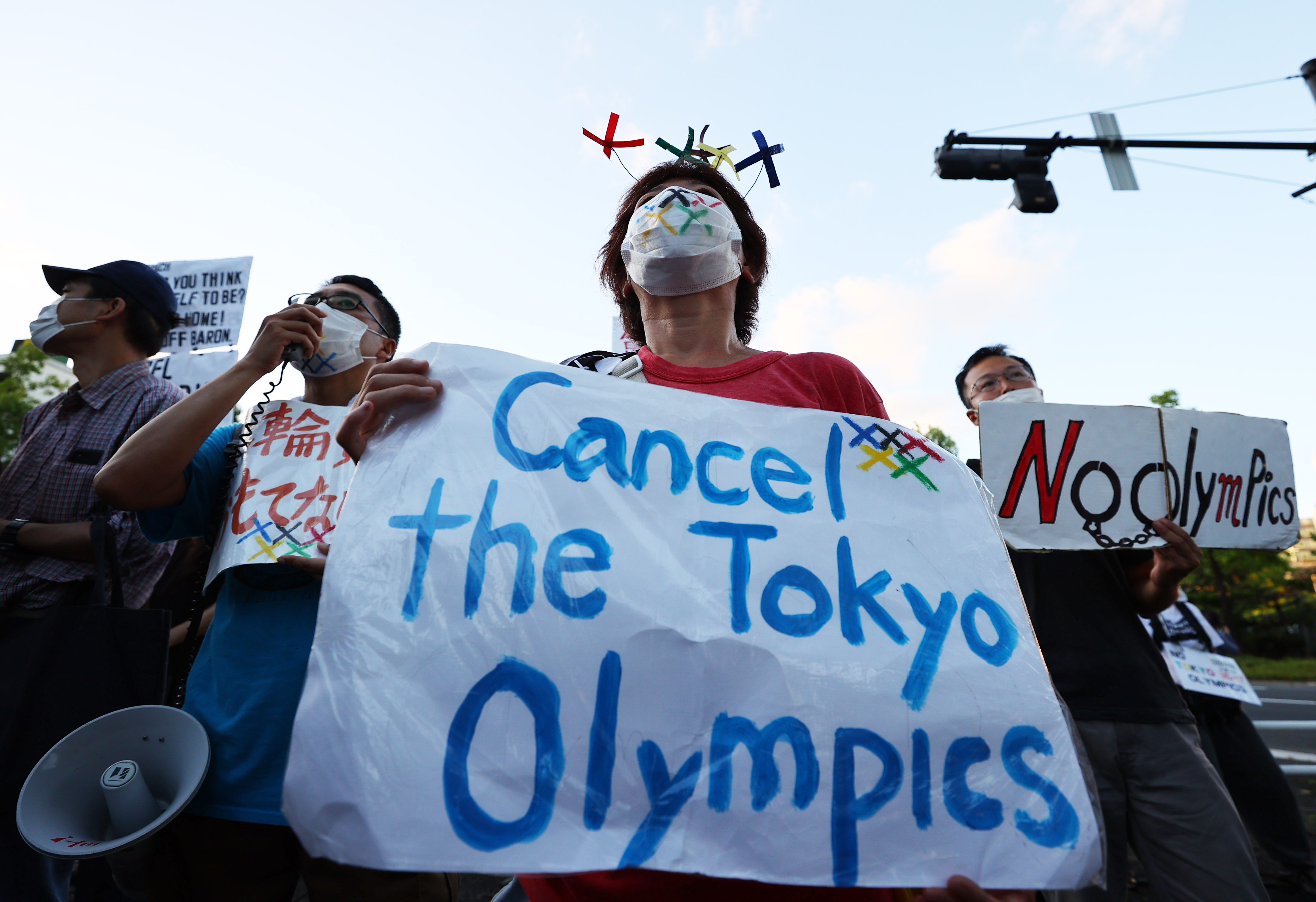 Tokyo 2020 Olympics - People protest against the Tokyo 2020 Olympic Games - Tokyo, Japan - July 18, 2021 Protesters during a rally near Akasaka State Guest where International Olympic Committee (IOC) President Thomas Bach attends a welcome ceremony hosted by the Japanese government REUTERS/Kim Kyung-Hoon