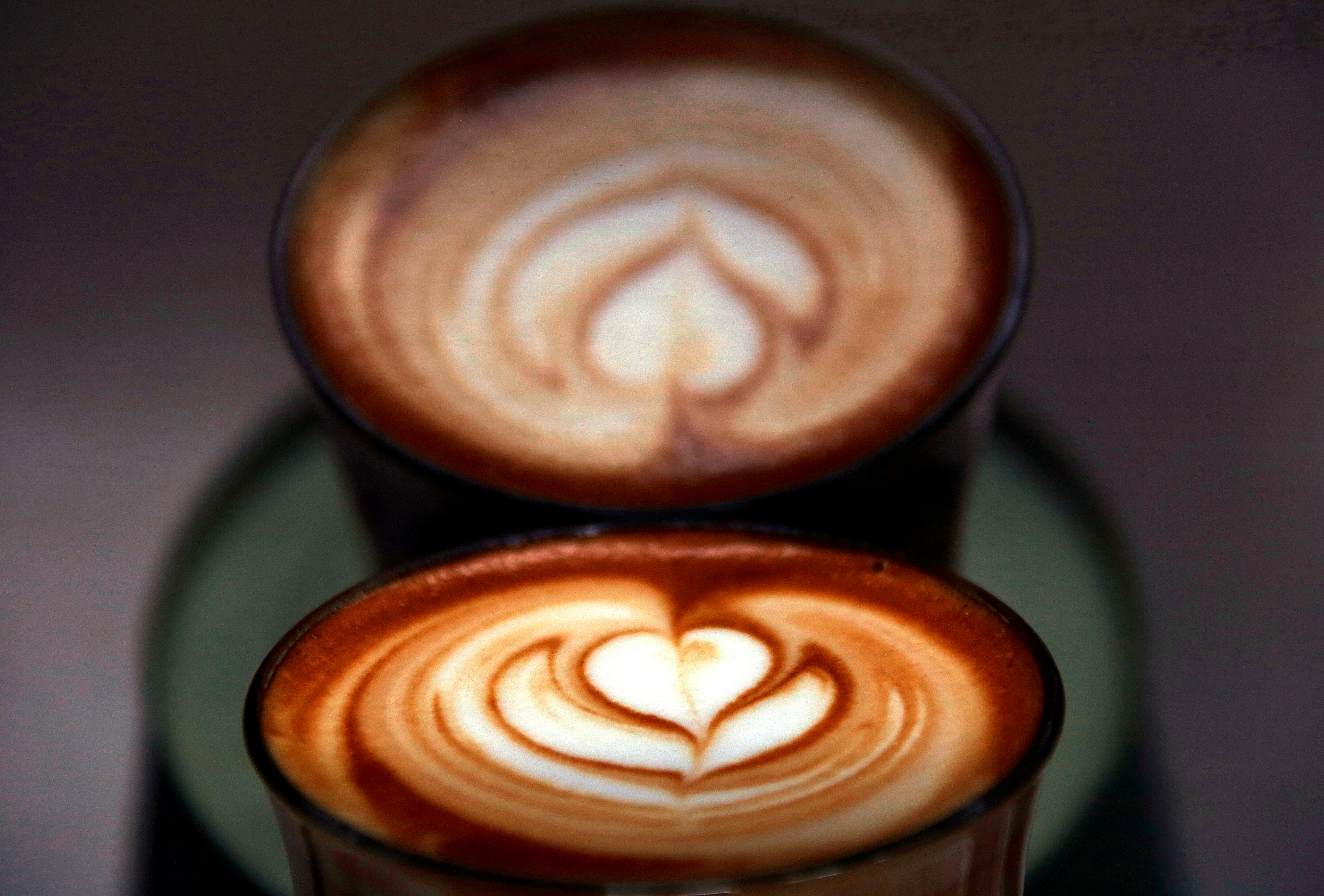 A photo illustration shows a coffee reflected in a coffee machine after it was made for a customer at a Sydney cafe in Australia, May 4, 2017.