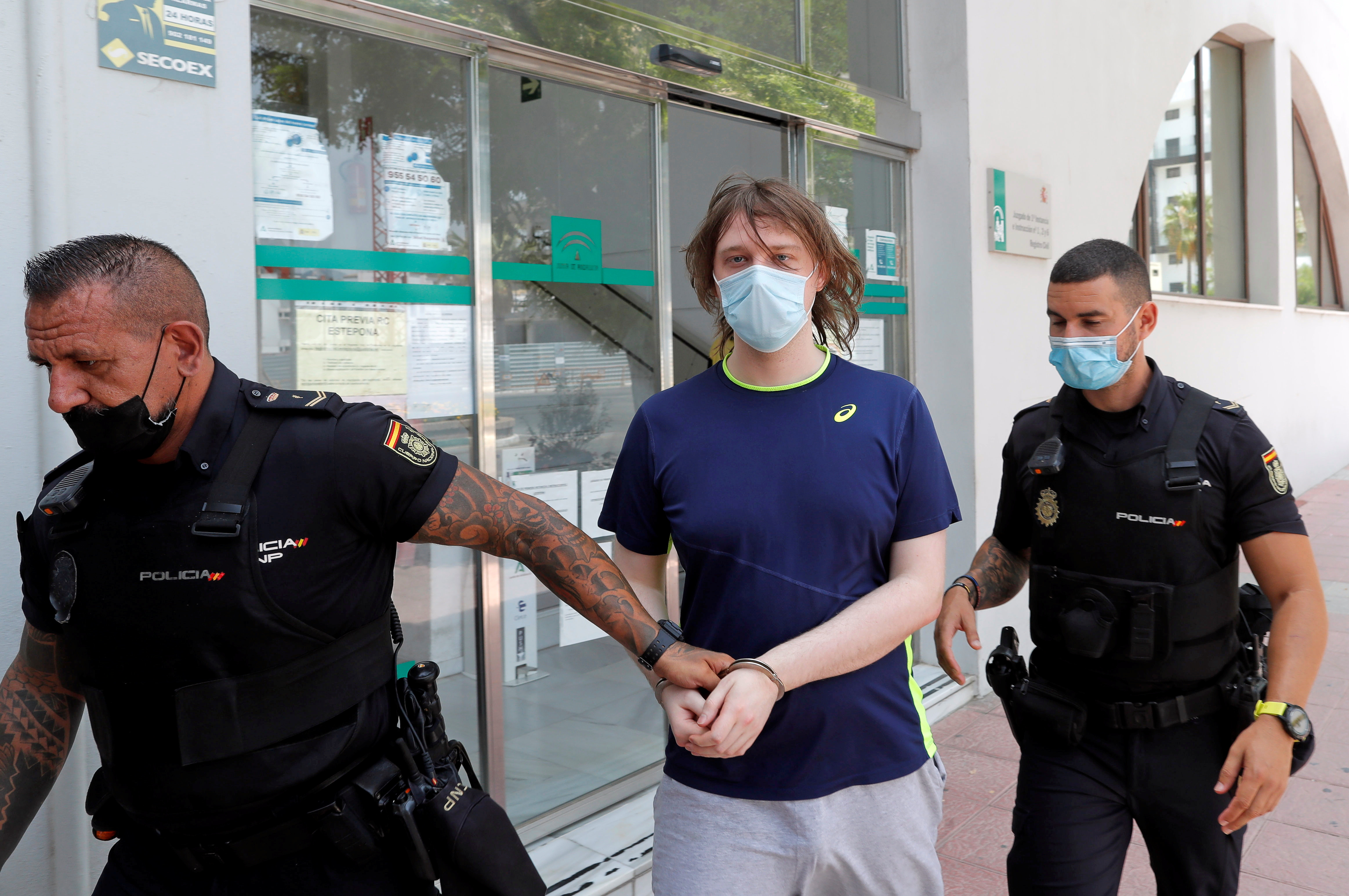 22-year-old British citizen Joseph James O'Connor is lead by Spanish police officers as he leaves a court after being arrested in connection with an alleged July 2020 Twitter hack which compromised the accounts of high-profile politicians and celebrities, according to the U.S. Justice Department, in Estepona, Spain, July 22, 2021. REUTERS/Jon Nazca