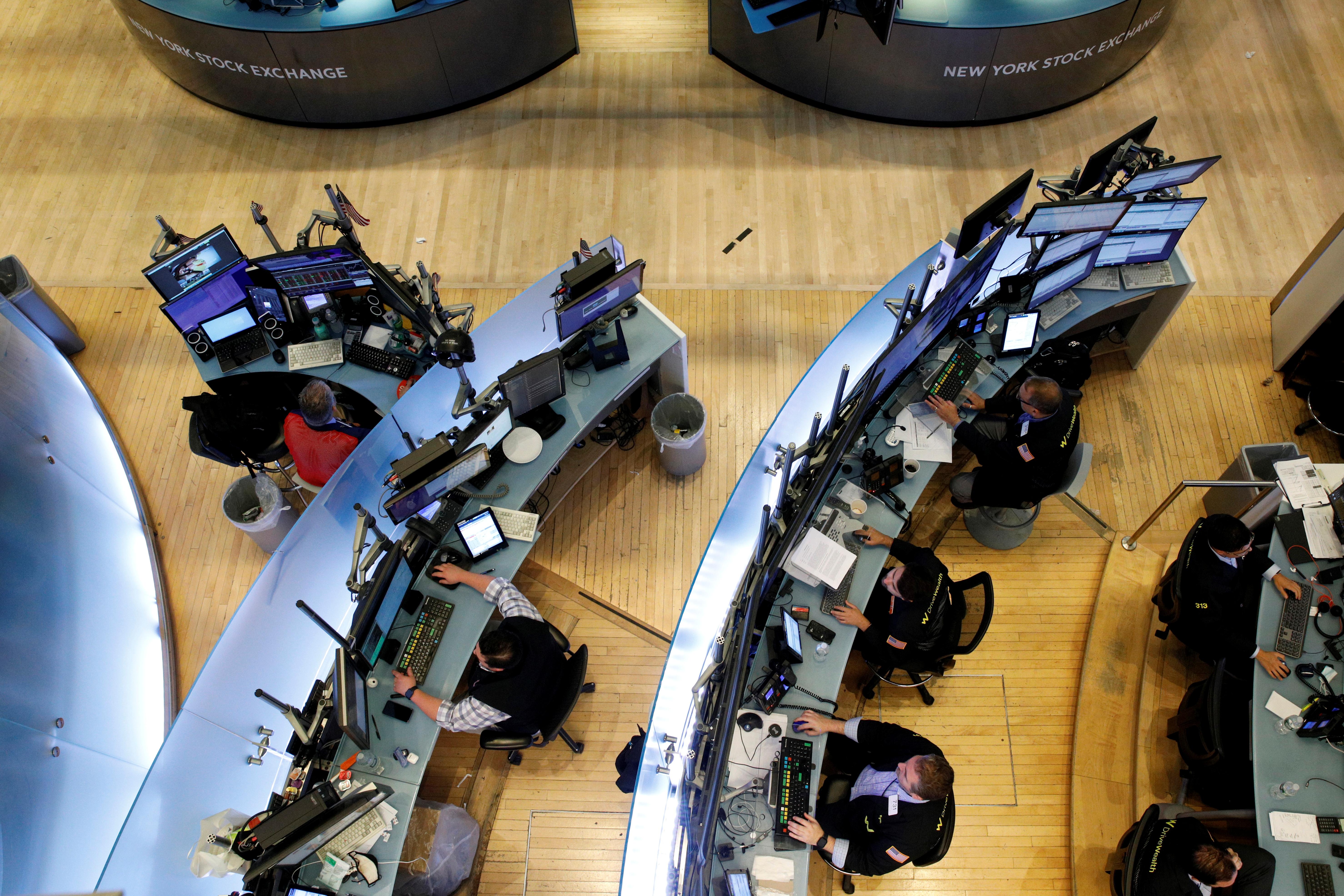 Traders work on the floor of the New York Stock Exchange (NYSE) in New York City, U.S., July 13, 2021.  REUTERS/Brendan McDermid