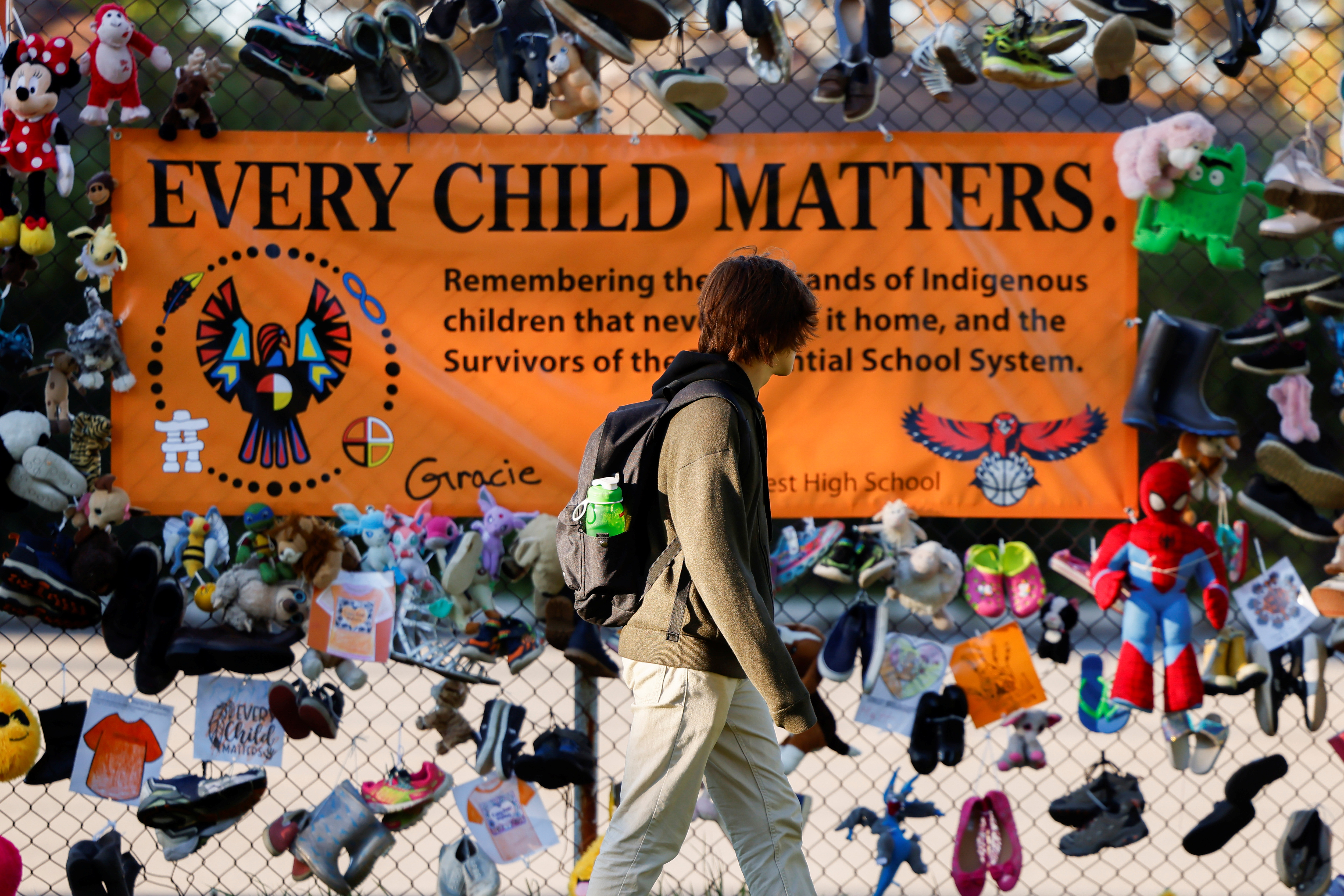 A student walks past a display at Hillcrest High School on Canada's first National Day for Truth and Reconciliation, honouring the lost children and survivors of Indigenous residential schools, their families and communities, in Ottawa, Ontario, Canada September 30, 2021. REUTERS/Blair Gable