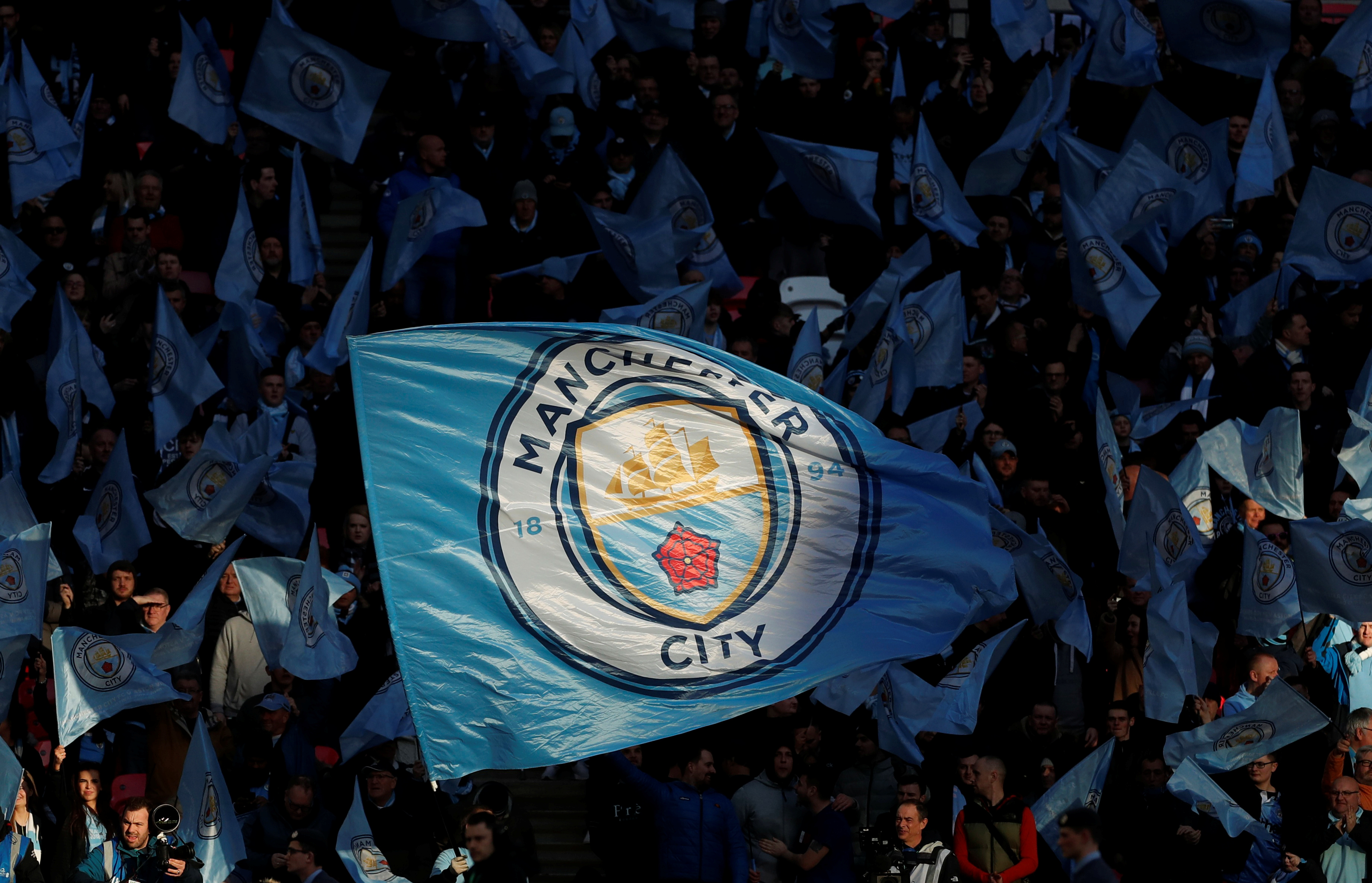 Soccer Football - Carabao Cup Final - Aston Villa v Manchester City - Wembley Stadium, London, Britain - March 1, 2020  Manchester City fans wave flags before the match   Action Images via Reuters/Lee Smith