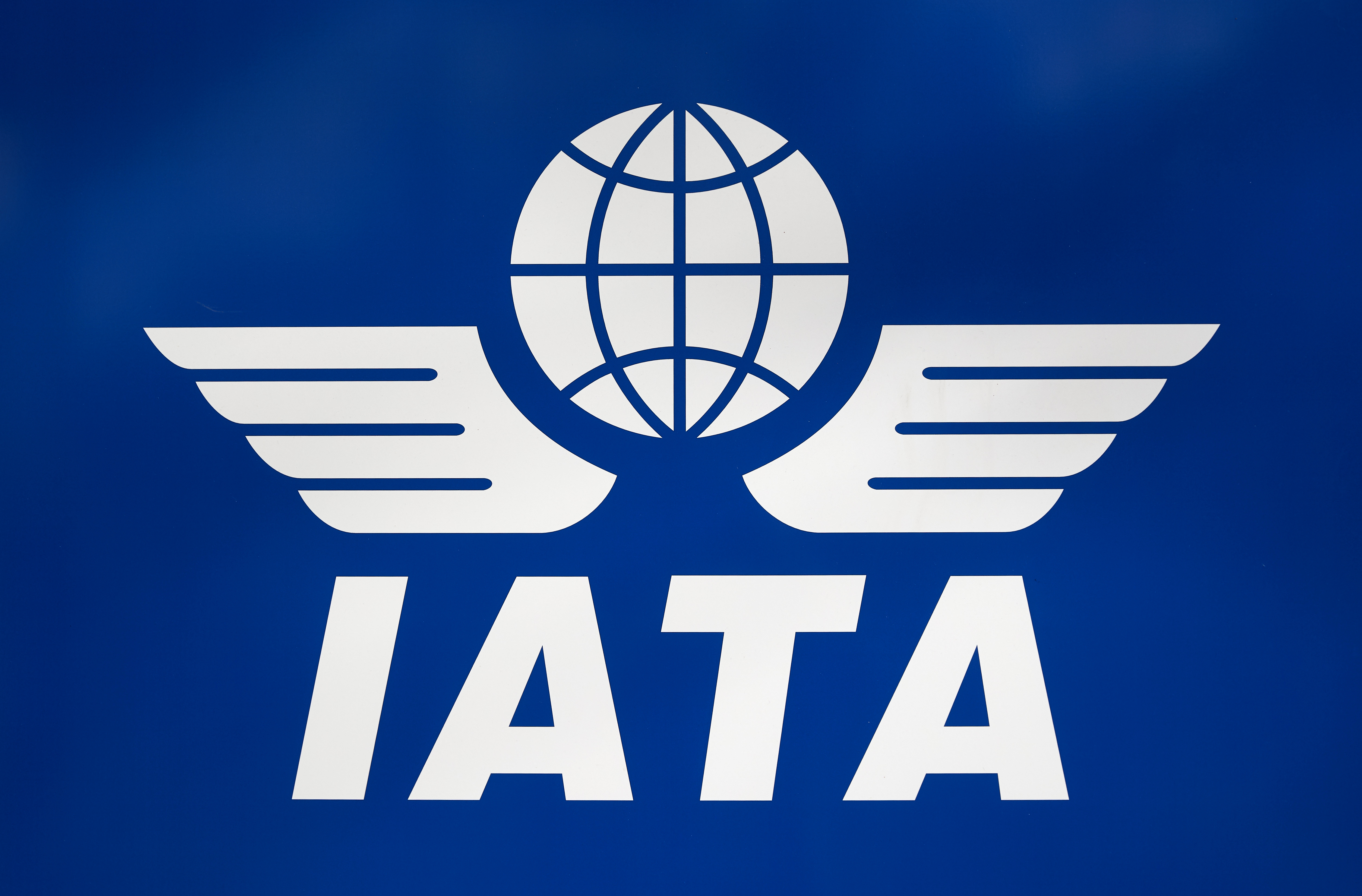 A logo of the International Air Transport Association (IATA) is pictured before and an interview with Reuters on the consequences of the outbreak of the coronavirus disease (COVID-19) in Geneva, Switzerland, March 13, 2020. REUTERS/Denis Balibouse