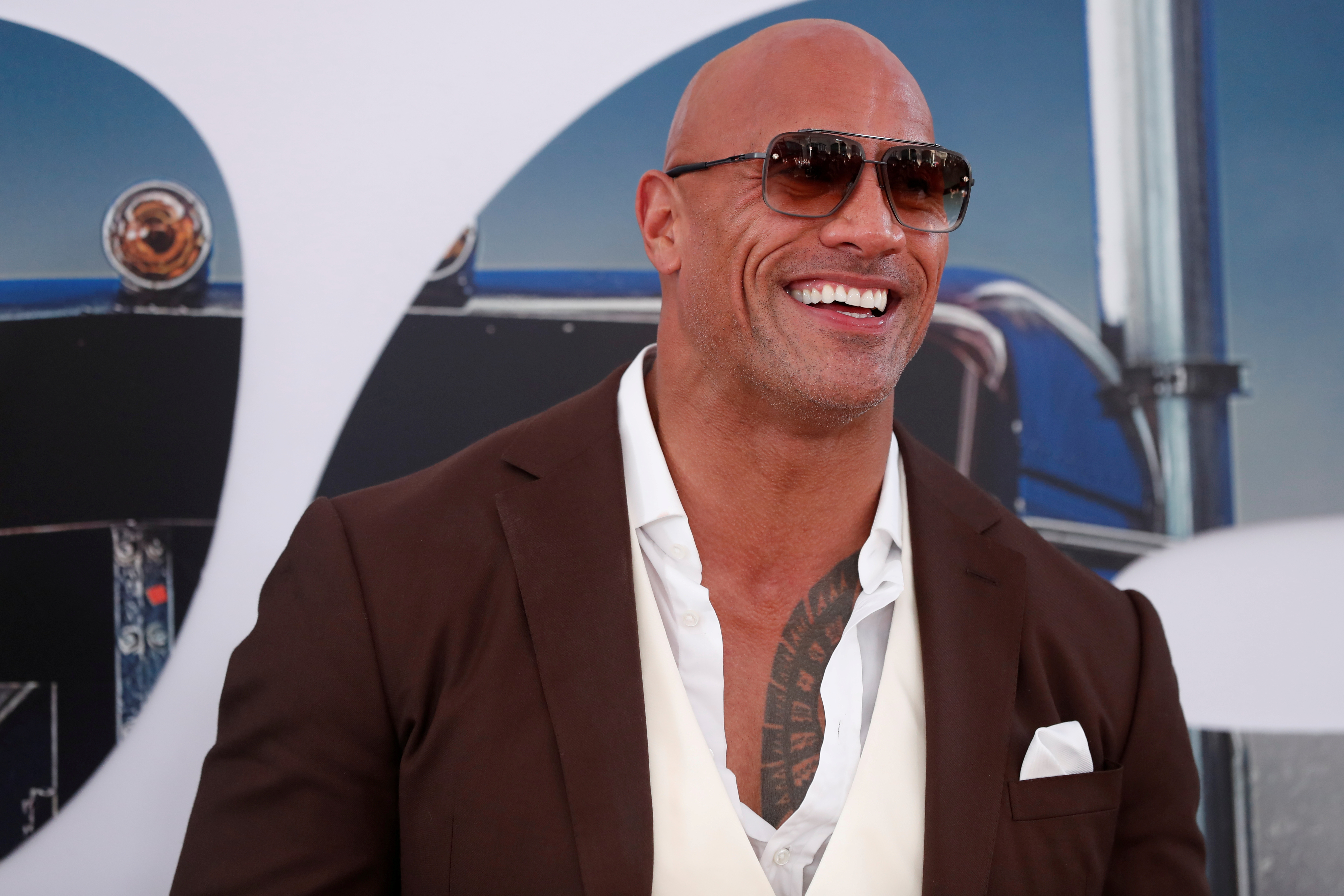 Cast member and producer Dwayne Johnson poses at the premiere for