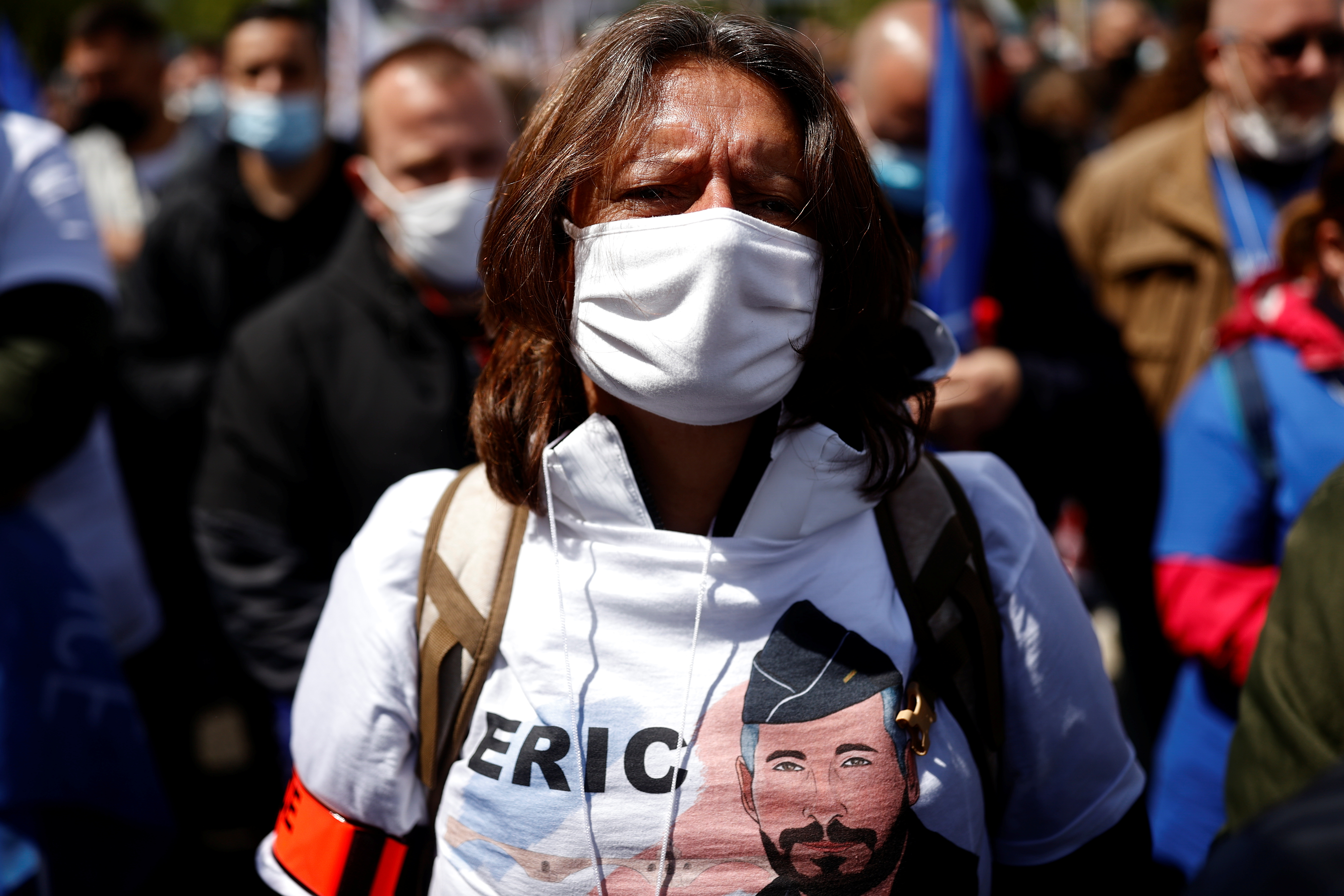 A police officer wears a t-shirt in tribute of late police officer Eric Masson, who was killed on May 5 during an anti-drug operation, as French police officers from all over France gather in front of the National Assembly in Paris to protest against violence against themselves and require a greater severity in the penal response to their aggressors, France, May 19, 2021. REUTERS/Christian Hartmann