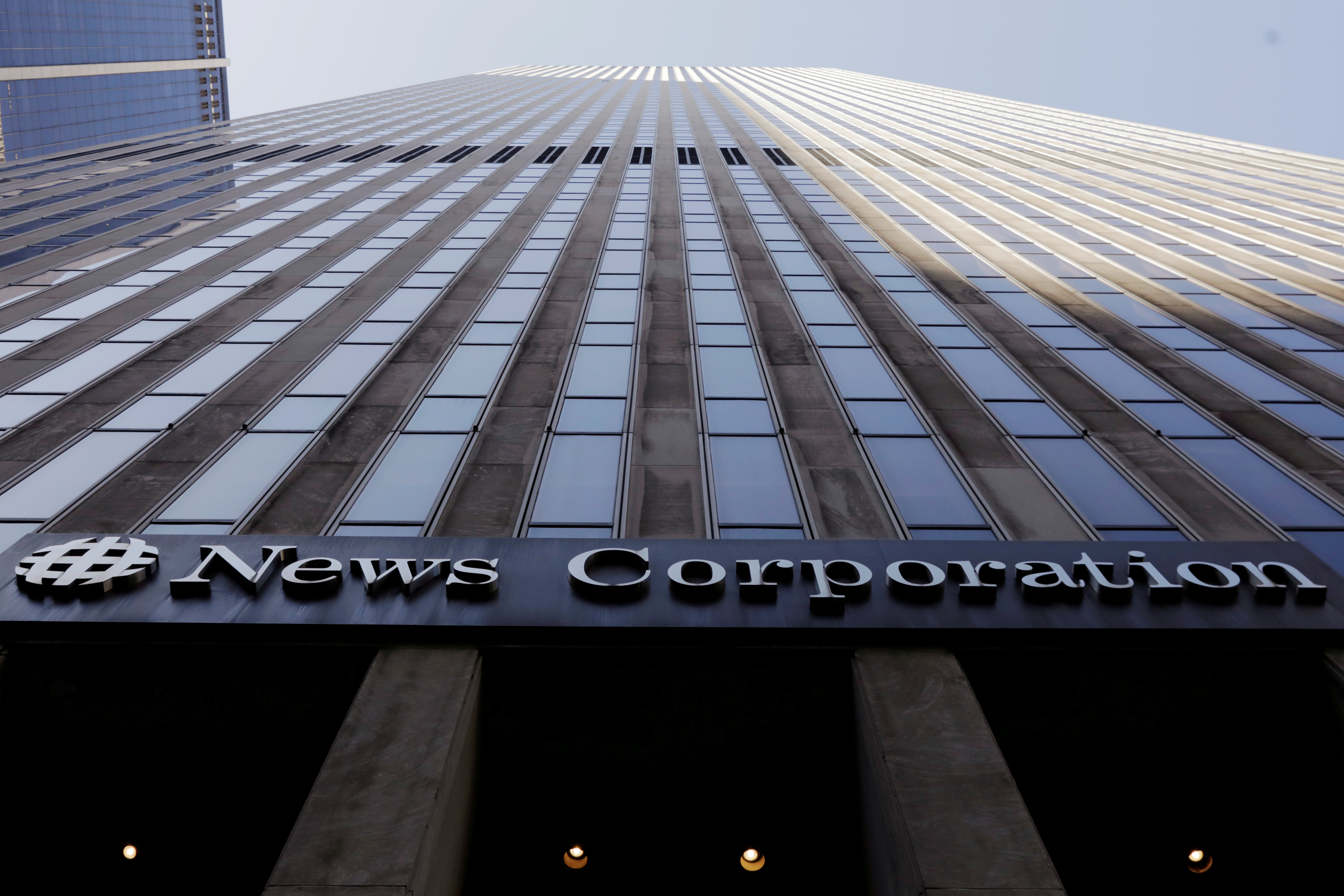 The News Corporation logo is displayed on the side of a building in midtown Manhattan in New York, U.S., February 27, 2018.  REUTERS/Lucas Jackson/File Photo